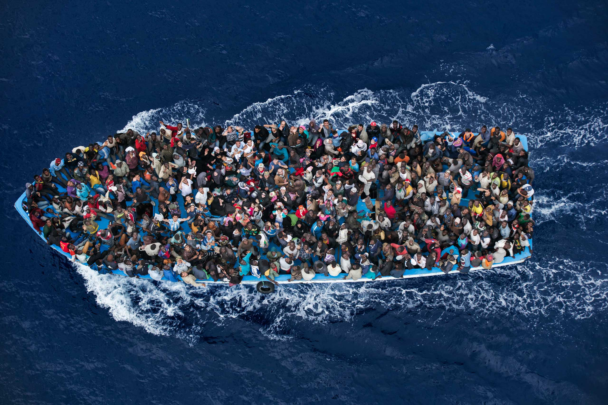 <b>Second Prize General News Category, Single</b>                                   Shipwrecked people are rescued aboard a boat 20 miles north of Libya by a frigate of the Italian navy.