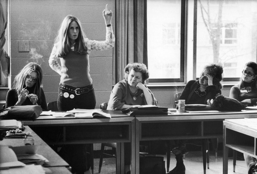 New York lawyer Brenda Feigen Fasteau, arm raised, argues about candidate support at a Washington meeting of the Caucus's National Policy Council. Some fellow members, left to right are: Ms. editor Gloria Steinem, National Organization for Women (NOW) president Wilma Scott Heide and author Betty Friedan.