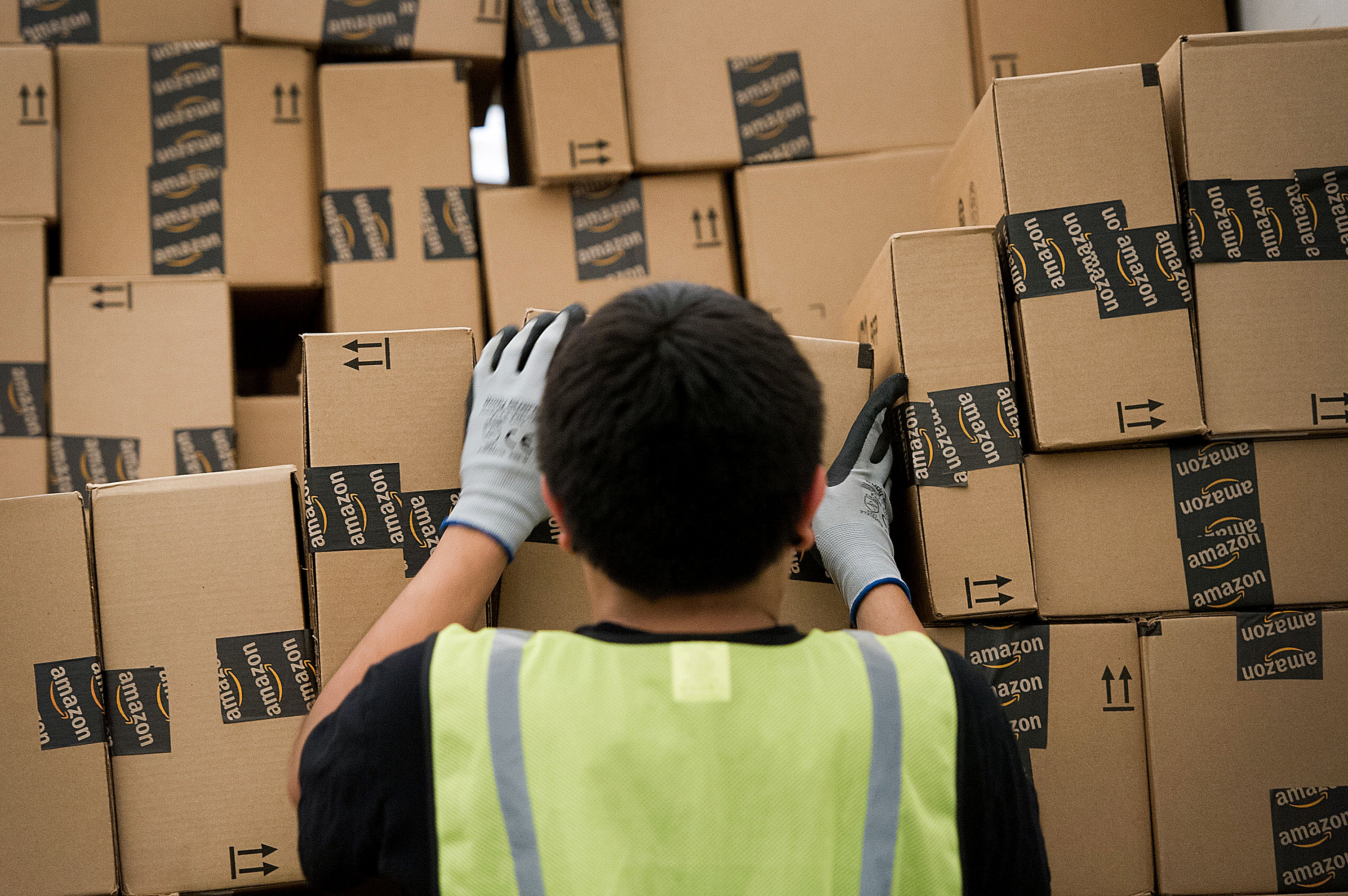An employee loads a truck with boxes to be shipped at the Amazon.com Inc. distribution center.