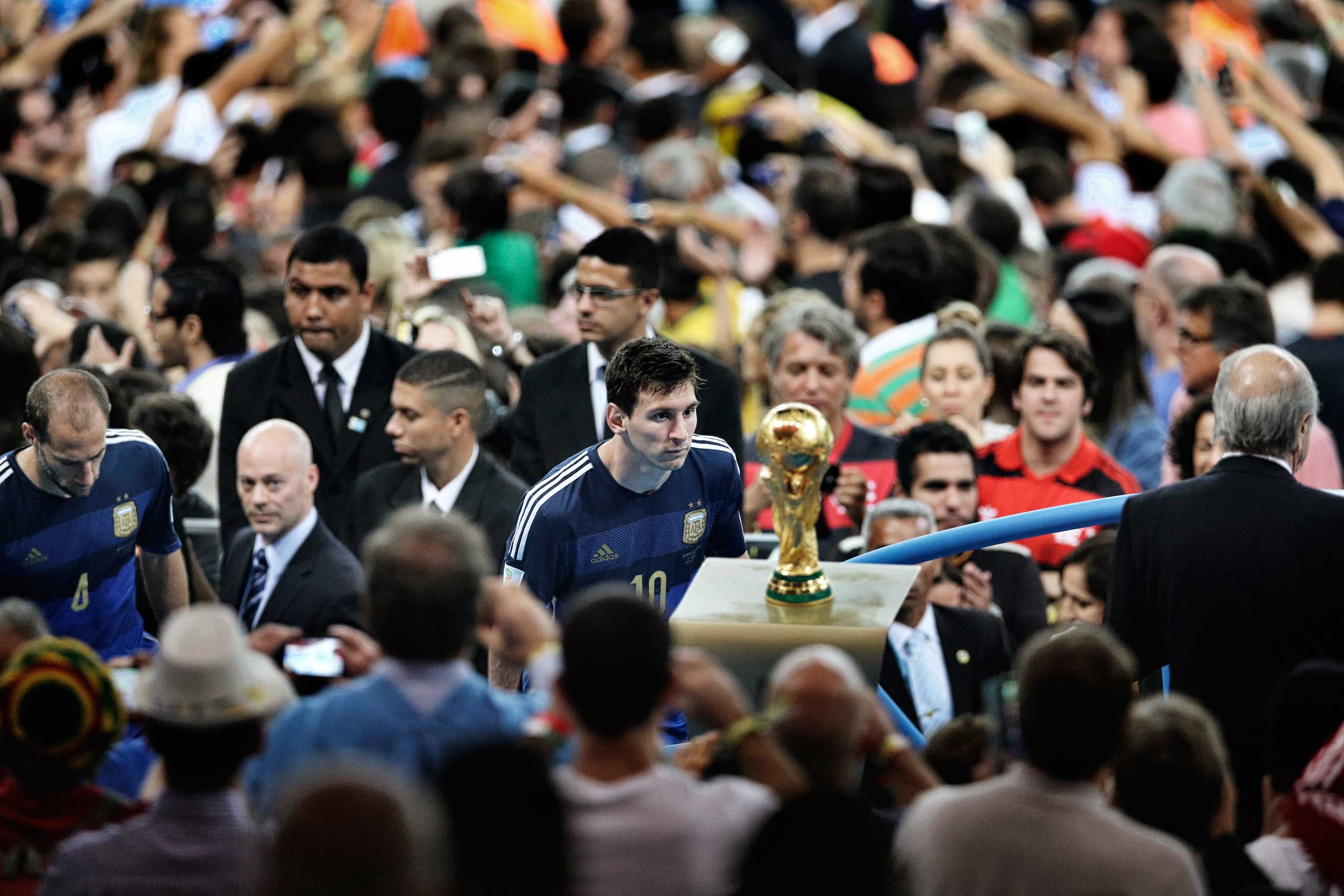 <b>First Prize Sports Category, Singles</b>                                   Argentina player Lionel Messi comes to face the World Cup trophy during the final celebrations at Maracana Stadium. His team lost to Germany 1-0, after a goal by Mario Götze in extra time.