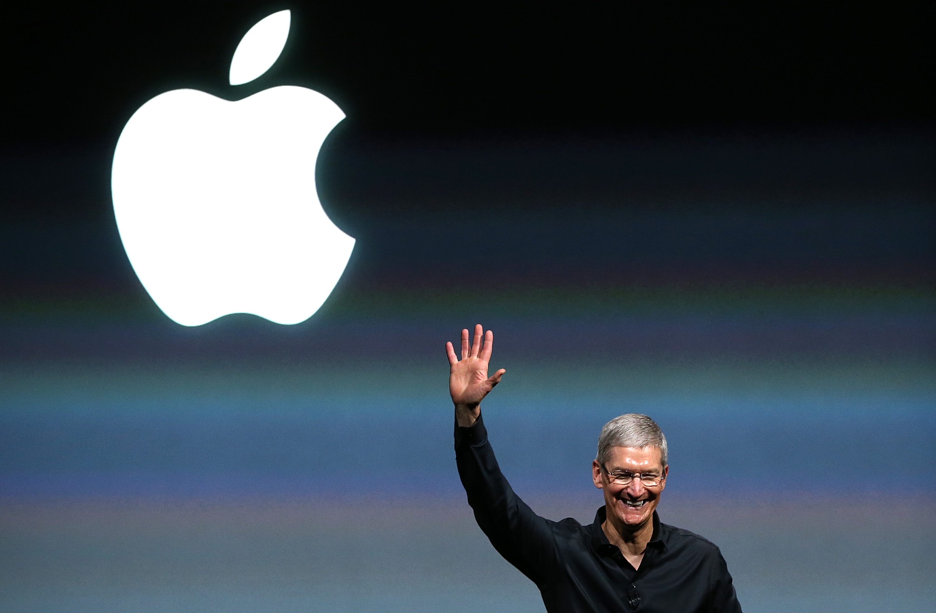 Apple CEO Tim Cook speaks during an Apple product announcement at the Apple campus on September 10, 2013 in Cupertino, California.