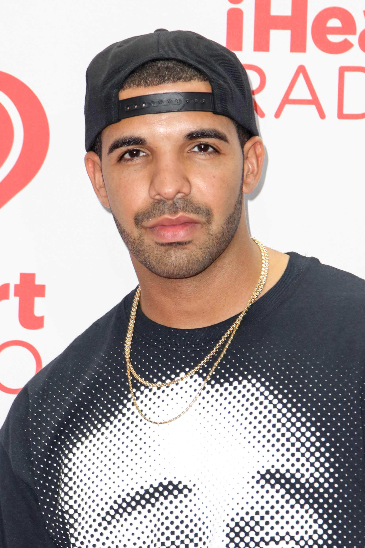 Singer Drake poses in the iHeartRadio music festival photo room on September 21, 2013 in Las Vegas, Nevada.