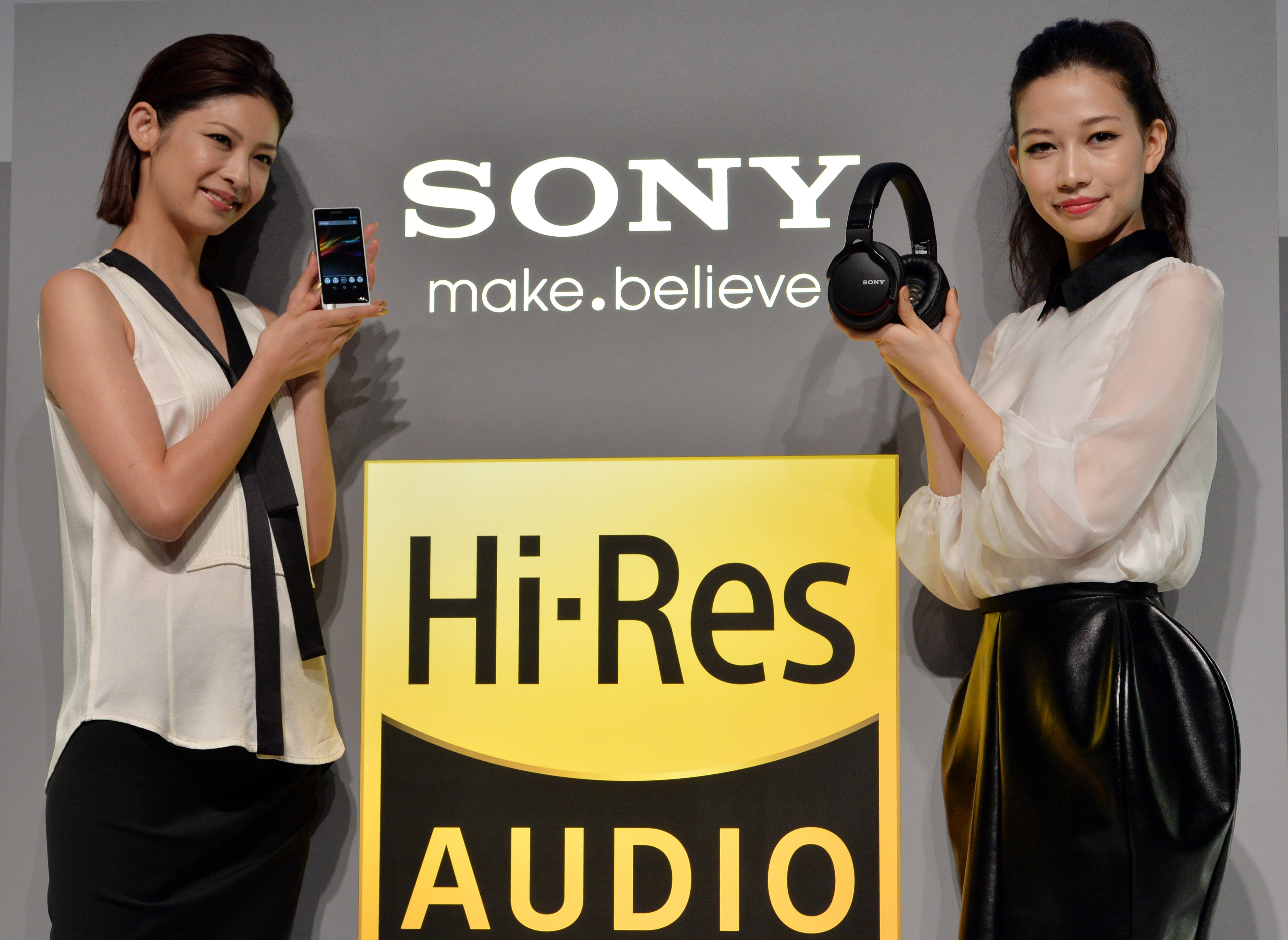 Models display Japanese electronics giant Sony's digital audio player  Walkman ZX-1  (L) and a headphone  MDR-1  as Sony unveiled the new series of high quality audio set series called  High-Resolution Audio  in Tokyo on September 26, 2013.
