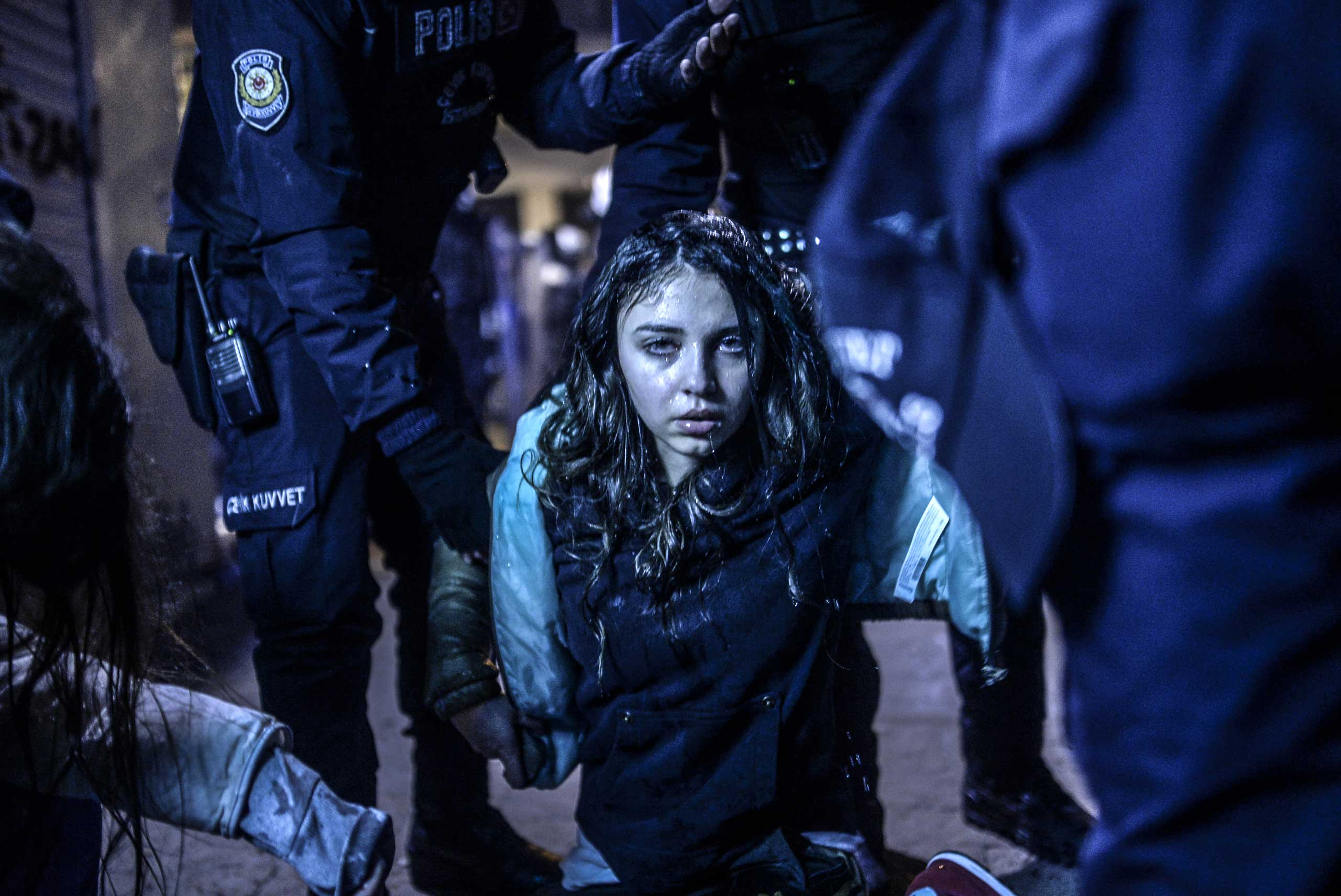 <b>First Prize Spot News Category, Singles</b>A young girl is pictured after she was wounded during clashes between riot-police and protestors in Istanbul on March 12, 2014.