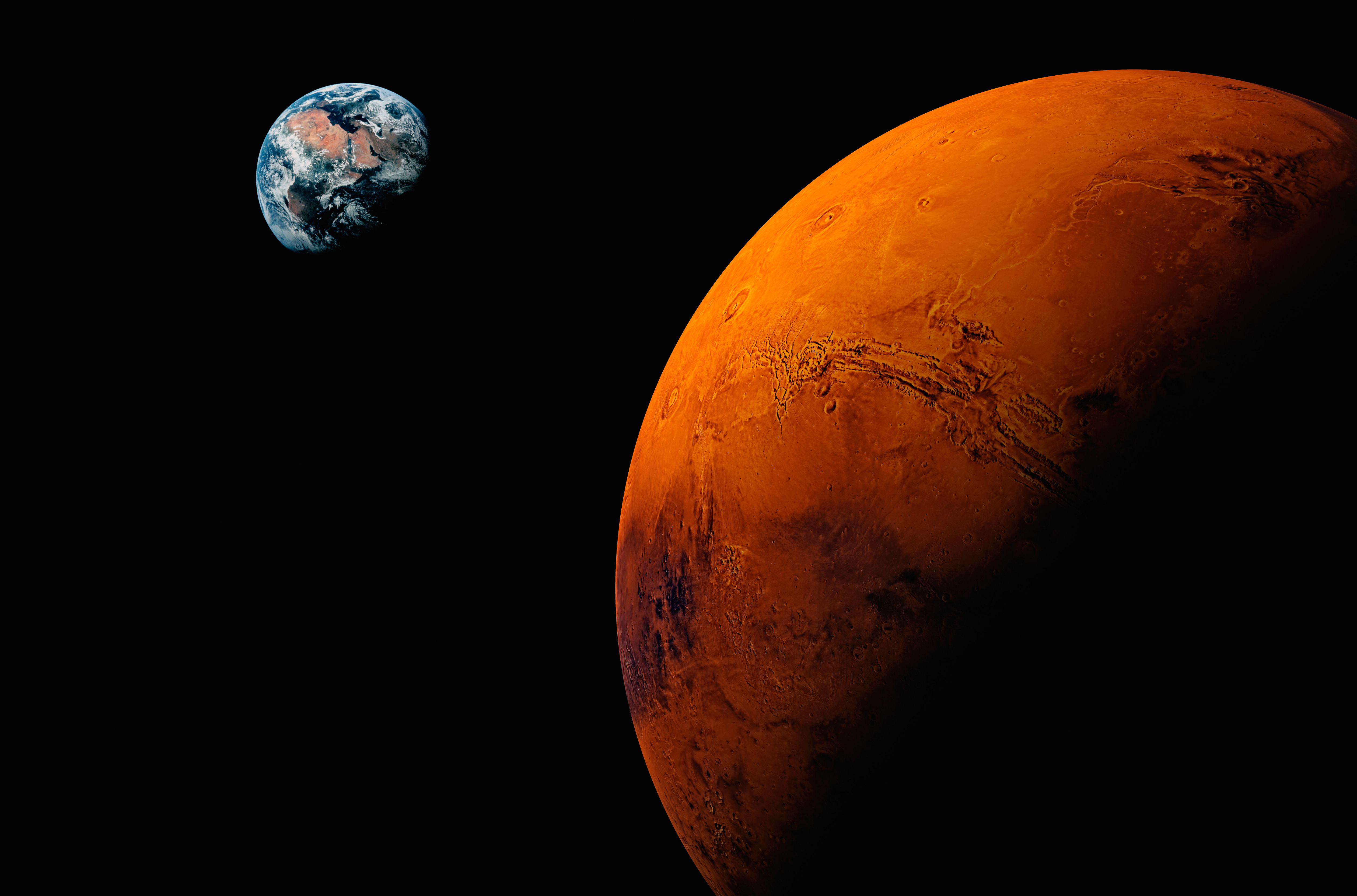 Planet Mars, with Earth visible in the background