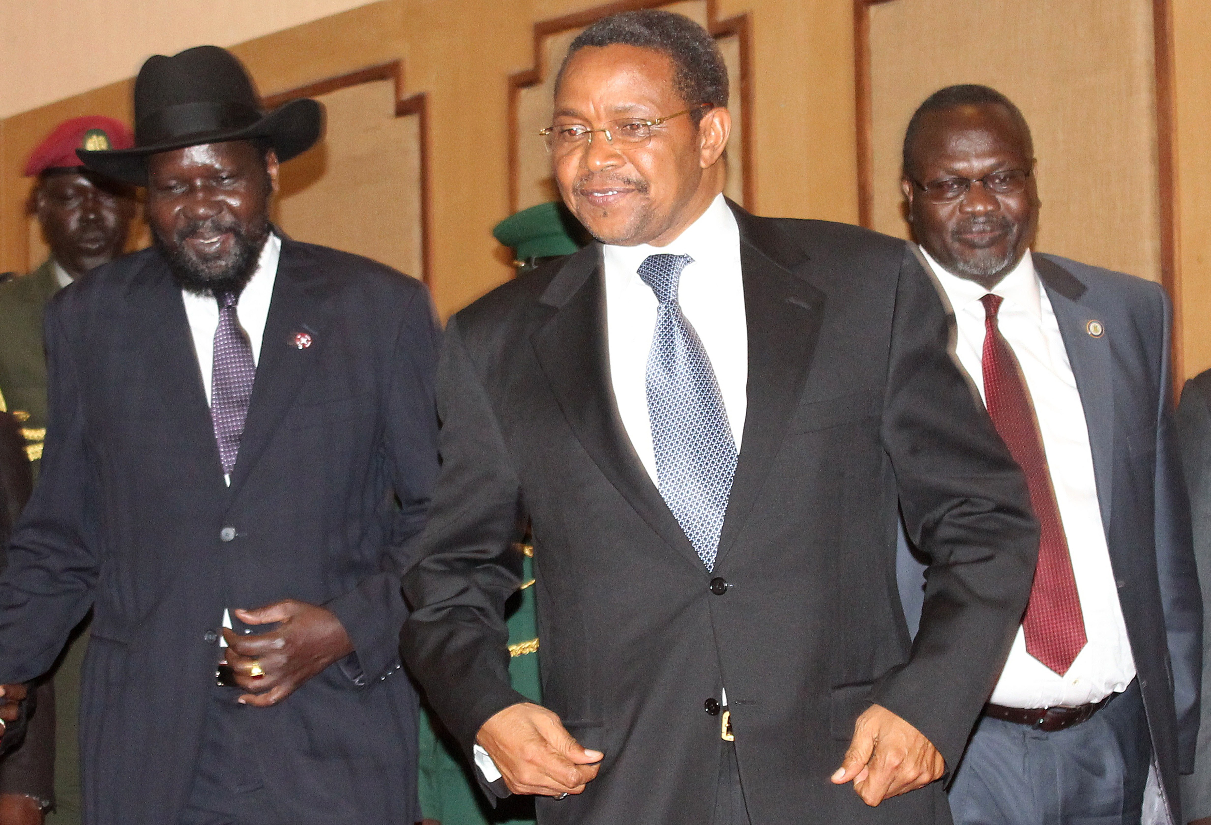 South Sudan's President Salva Kiir, left; Tanzania's President Jakaya Kikwete, center; and South Sudanese rebel leader Riek Machar, right, pose during talks on Oct. 20, 2014, in the northern Tanzanian tourist town of Arusha