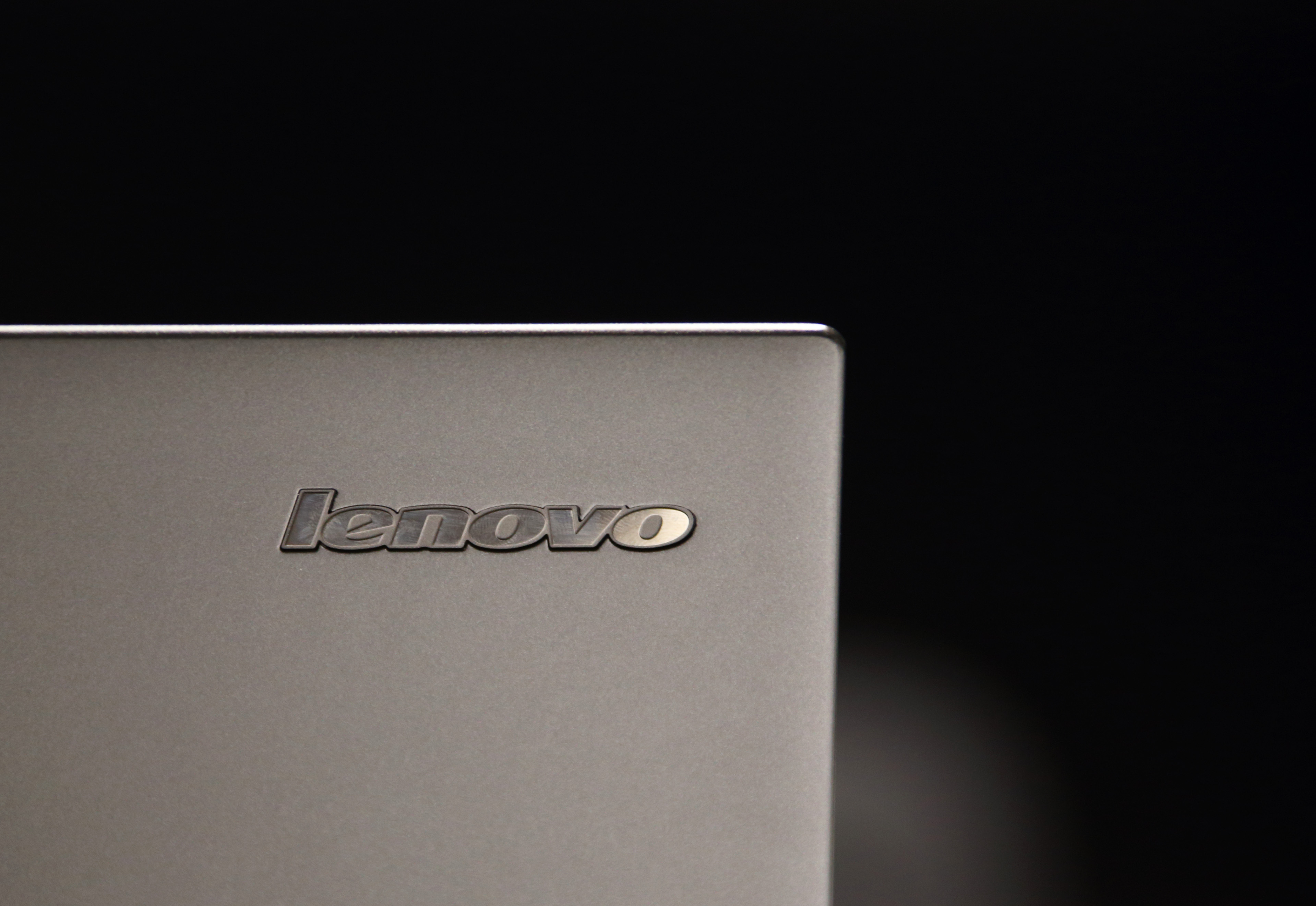 A Lenovo Group Ltd. logo is seen on a laptop computer displayed at the company's flagship store on Qianmen Street in Beijing, China, on Tuesday, Nov. 11,