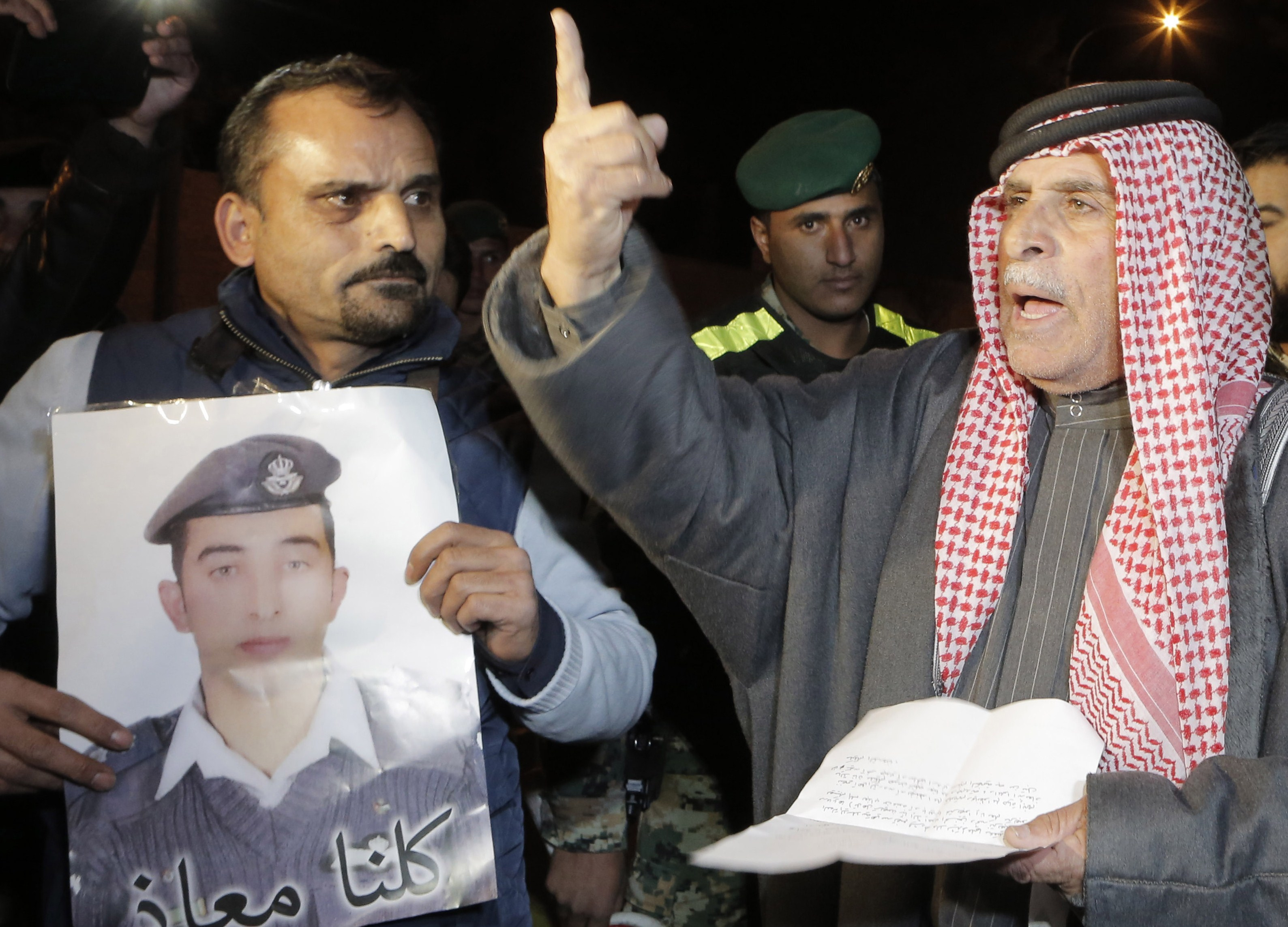 Safi al-Kasasbeh, right, the father of Jordanian pilot Moaz al-Kasasbeh (portrait), who was captured by ISIS militants on December 24, protests outside the Royal court in Amman on Jan. 28, 2015.