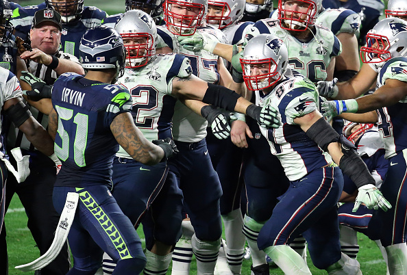 Bruce Irvin #51 of the Seattle Seahawks and  Rob Gronkowski #87 of the New England Patriots exchange words late in the fourth quarter during Super Bowl XLIX at University of Phoenix Stadium on Feb. 1, 2015 in Glendale, Arizona
