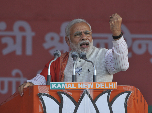 Prime Minister Narendra Modi addresses an election rally at Ambedkar Nagar in New Delhi on Feb. 4, 2015