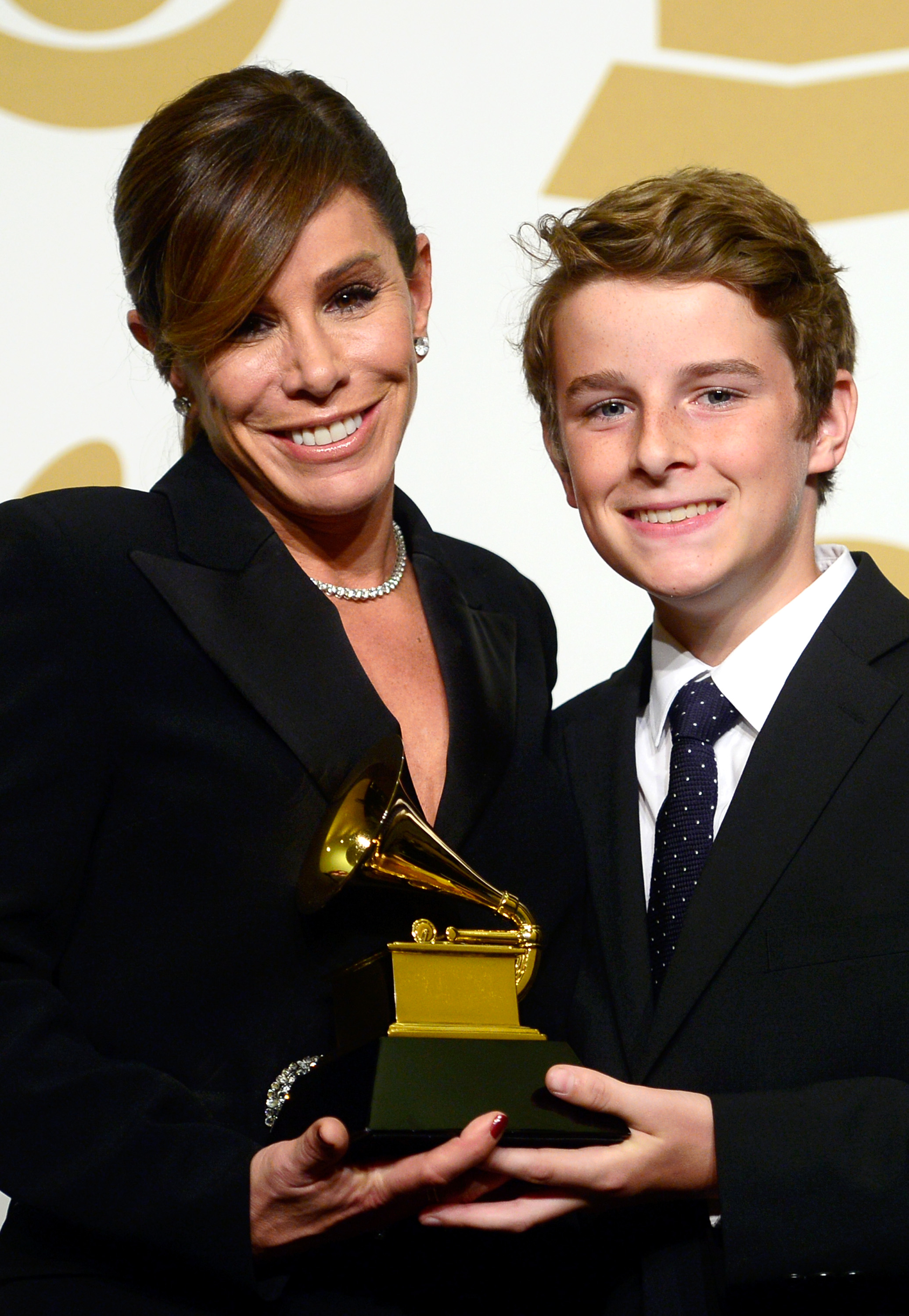 Melissa Rivers (L) and son Cooper Endicott accept Best Spoken Word Album for 'Diary Of A Mad Diva' on behalf of Joan Rivers during The 57th Annual GRAMMY Awards on Feb. 8, 2015 in Los Angeles.
