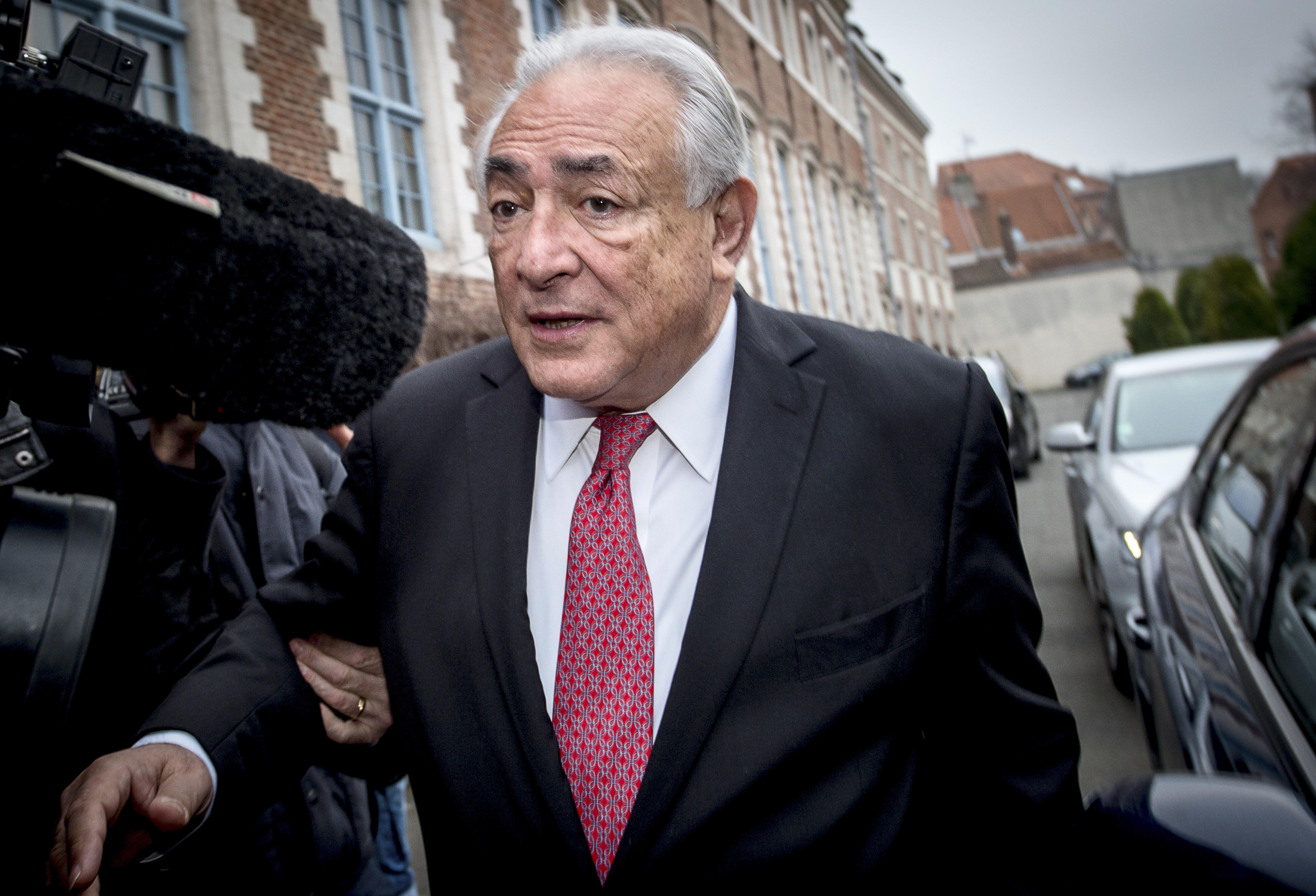 Ex-IMF chief Dominique Strauss-Kahn  leaves his hotel  on his way to the Lille courthouse, northern France, on February 12, 2015.