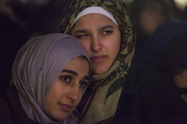RALEIGH, USA - February 12: Friends comfort each other at a vigil for Deah Shaddy Barakat, his wife Yusor Abu-Salha, and her sister Razan Abu-Salha on the campus of North Carolina State University in Raleigh, USA on February 12, 2015. Muslim students Deah Barakat, 23, his wife Yusor Mohammad Abu-Salha, 21, and her sister Razan Mohammad Abu-Salha, 19, were shot dead at their home on Tuesday in Chapel Hill, North Carolina. (Photo by Samuel Corum/Anadolu Agency/Getty Images)
