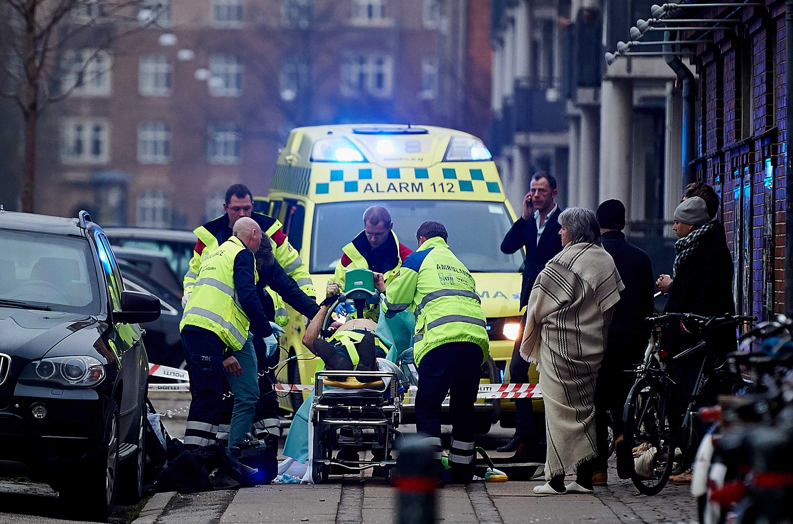 A victim is carried into an ambulance after a shooting at a public meeting and discussion arranged by the Lars Vilks Committee about Charlie Hebdo and freedom of speech on Feb. 14, 2015 in Copenhagen.
