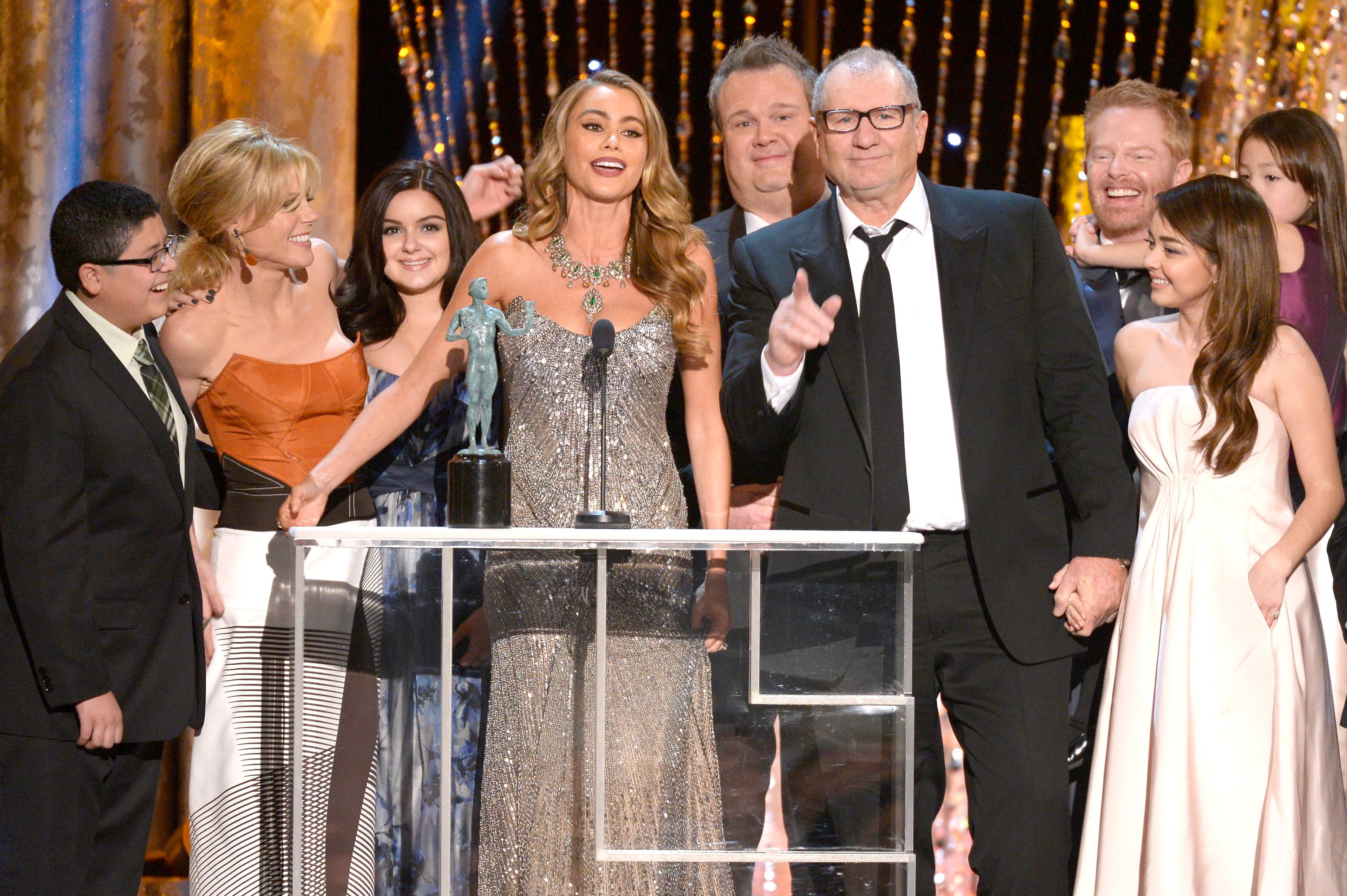 (L-R) Actors Rico Rodriguez, Julie Bowen, Ariel Winter, Sofia Vergara, Eric Stonestreet, Ed O'Neill, Jesse Tyler Ferguson, Sarah Hyland and Aubrey Anderson-Emmons accept the Outstanding Performance by an Ensemble in a Comedy Series award for 'Modern Family' onstage during the 20th Annual Screen Actors Guild Awards in Los Angeles on Jan. 18, 2014.