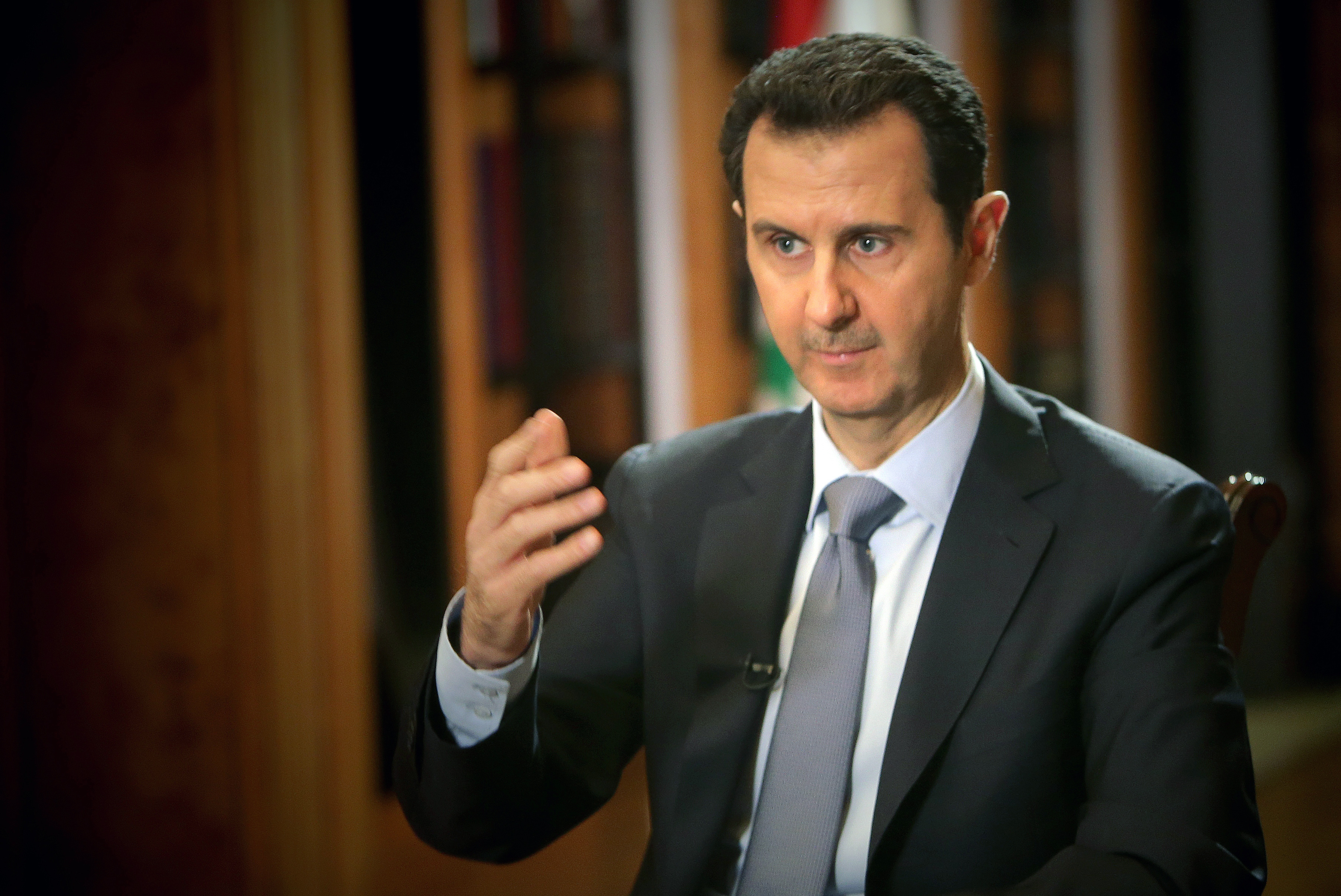 Syrian President Bashar al-Assad speaks during an interview with AFP at the presidential palace in Damascus on January 20, 2014.