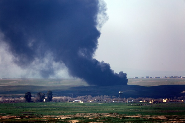 ISIS members set fire to tires Sunday to mask their escape after clashing with Kurdish peshmerga forces outside Mosul.
