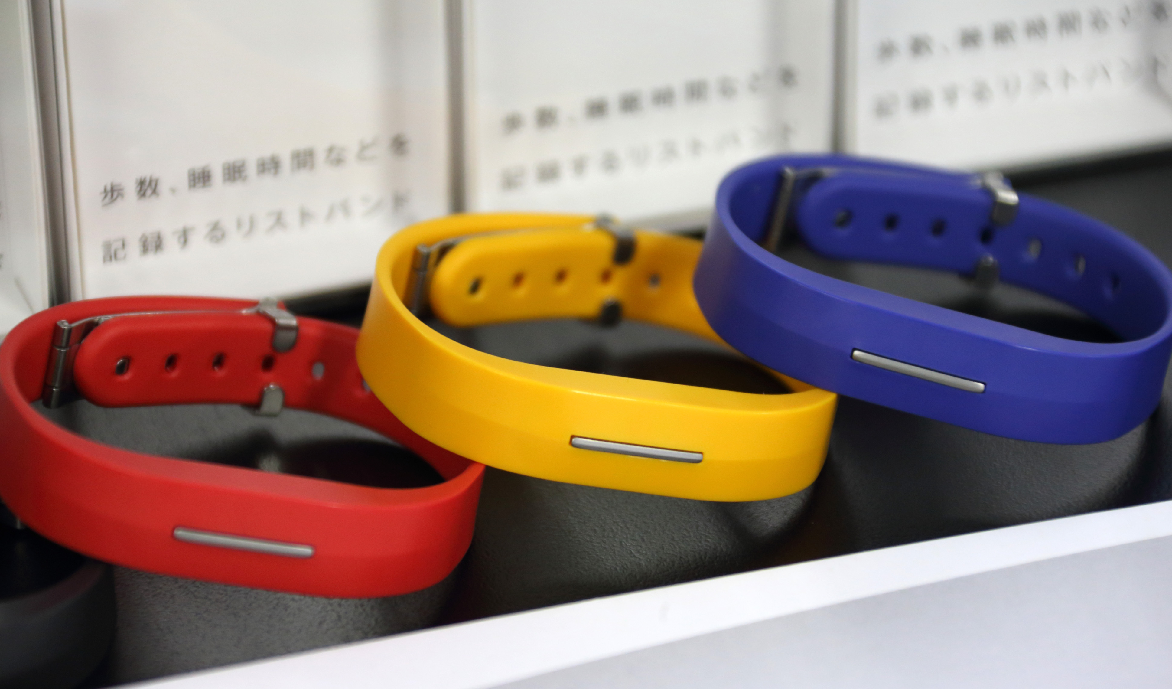 Docomo Healthcare Inc.'s Moveband, a wearable technology device for easy recording and tracking of health data, manufactured by Toshiba Corp., are displayed during a news conference in Kawasaki City, Kanagawa Prefecture, Japan, on Thursday, Feb. 20, 2014.