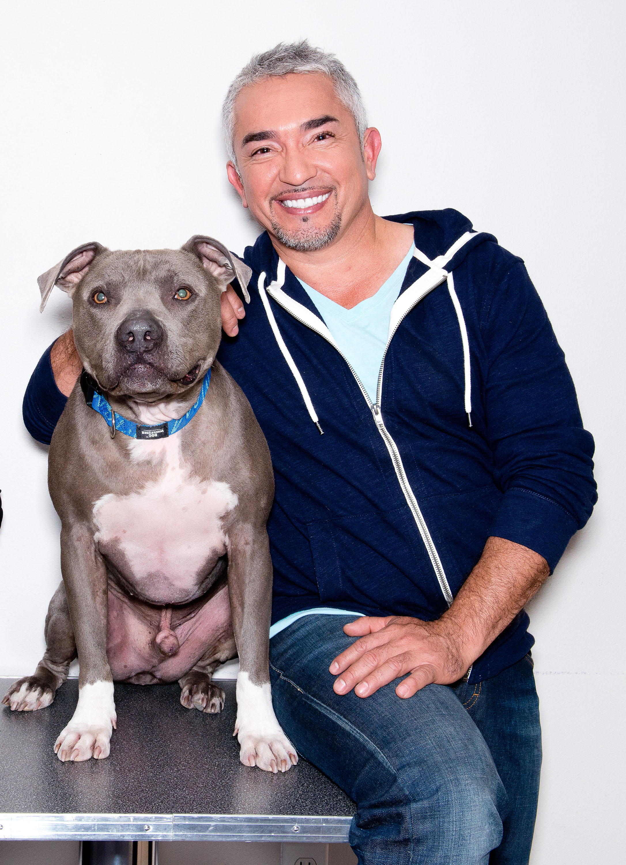 Dog Whisperer Cesar Millan poses with his pit bull Junior after his performance at Route 66 Casinos Legends Theater on April 11, 2014 in Albuquerque, New Mexico.