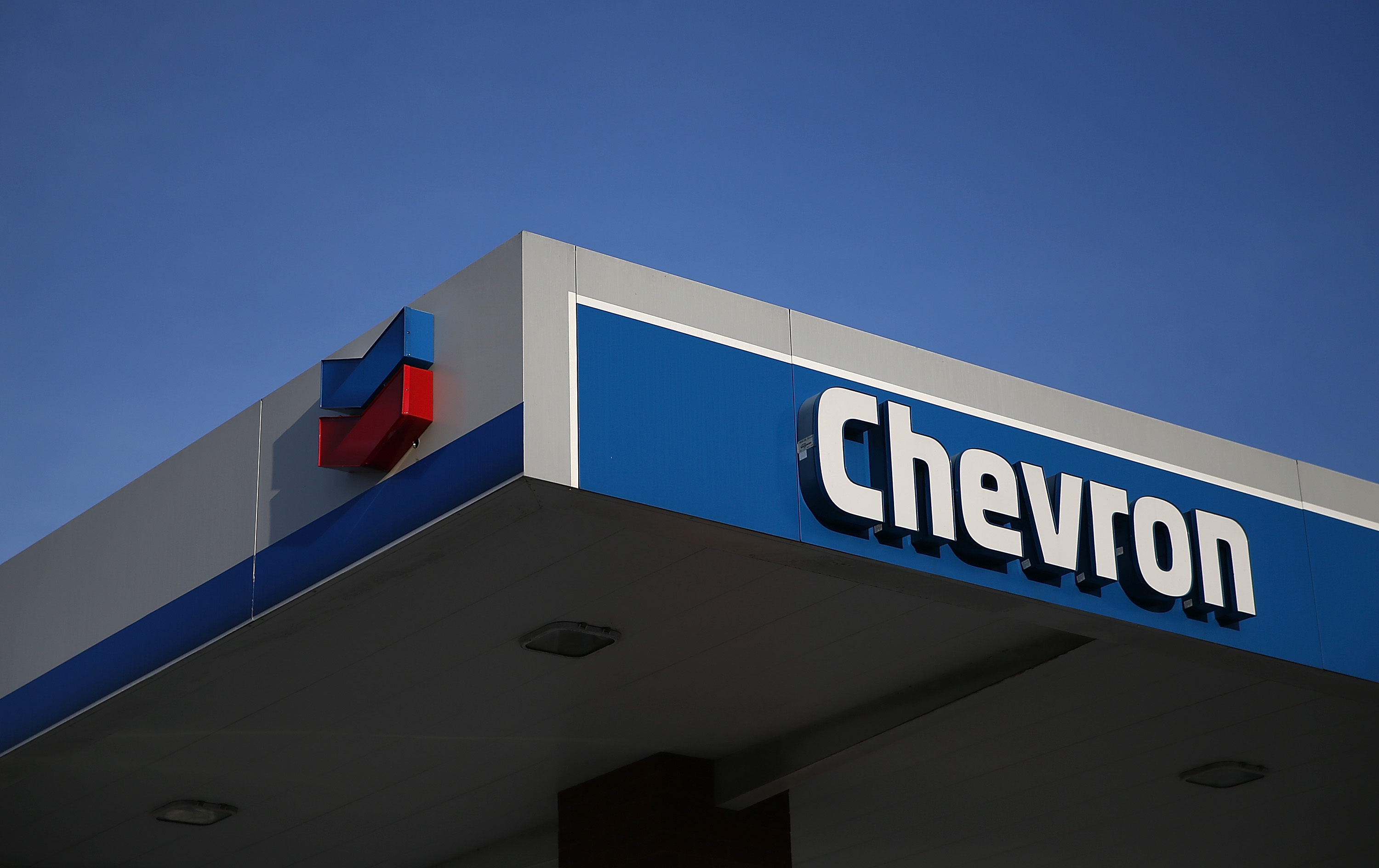 The Chevron logo is displayed at a Chevron gas station on May 2, 2014 in Greenbrae, California.