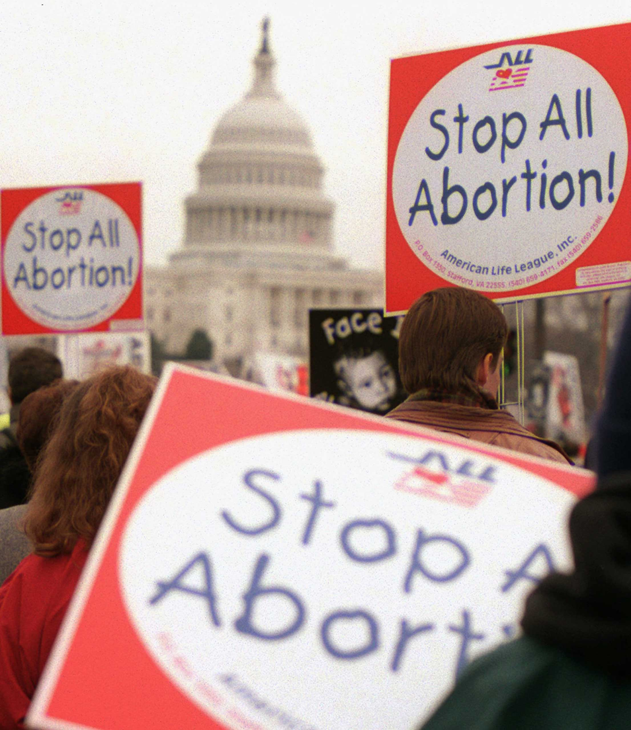 """<b>Partial-birth Abortion, Clinton, 1996</b> President Clinton drew the ire of religious and anti-abortion groups in 1996 when he vetoed the """"partial-birth abortion bill""""' which outlawed certain abortion procedures even when they would save the life of the mother. Clinton called the measure """"potentially life-saving, certainly health-saving."""" The bill was later signed into law by President George W. Bush. (Photo: Anti-abortion supporters in Washington on Jan. 22,1997.)"""