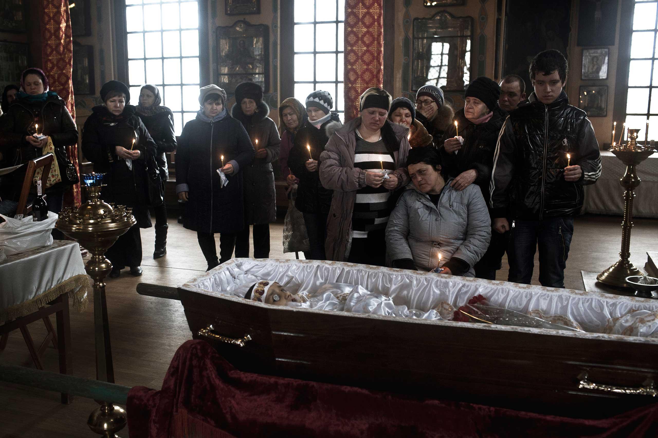 Funeral of seven-year-old Igor Molodetskykh, killed in a shelling by separatist rebels, is held in Artemivsk, Ukraine, Feb. 15, 2015.