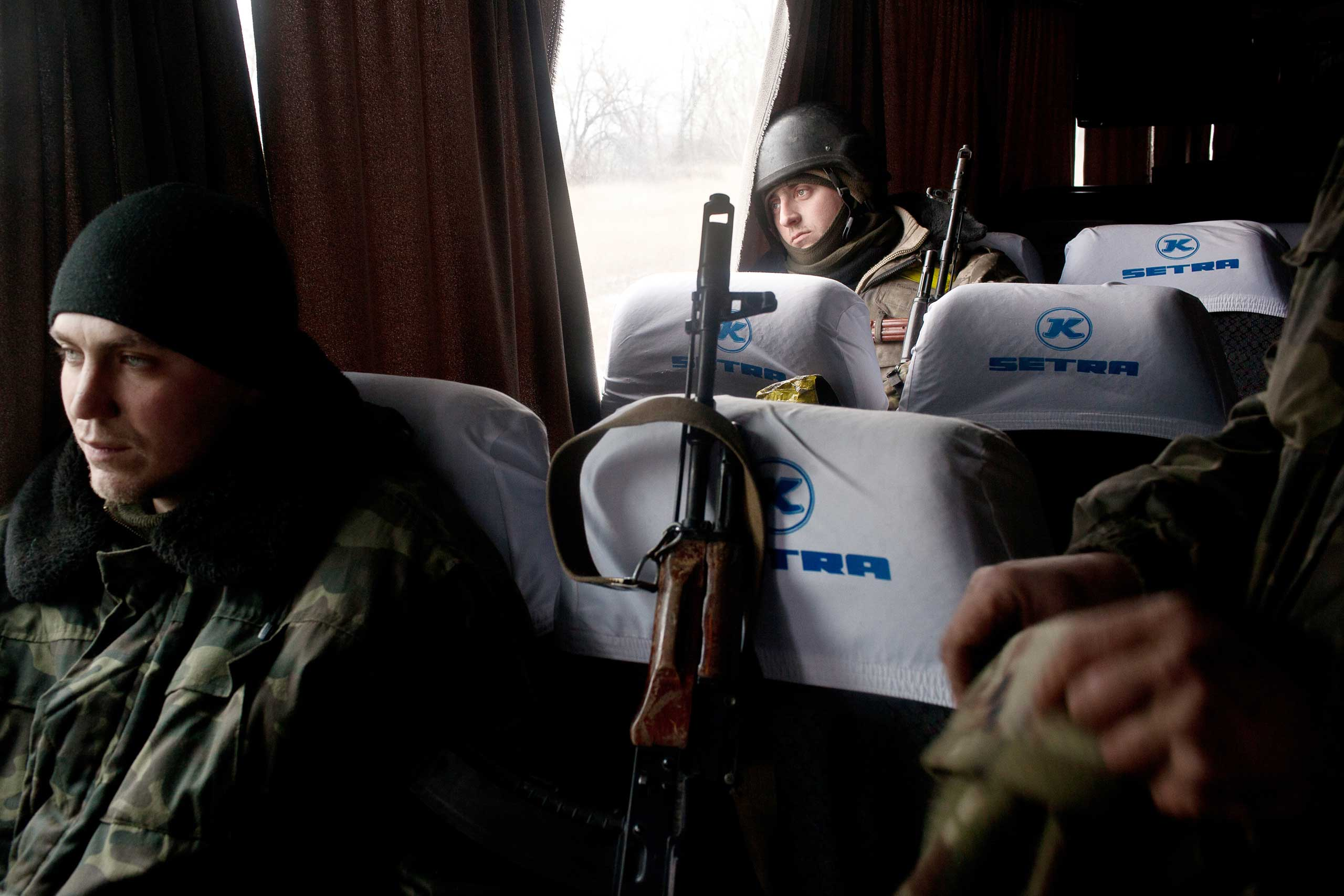 A Ukrainian soldier stares out a bus window as Ukrainian troops withdraw in defeat from the city of Debaltseve, Feb. 19, 2015. After almost a month of fighting and heavy shelling on the road out of the city, Ukrainian fighters return to the nearby town of Artemivsk. The Minsk 2 ceasefire has been largely ignored with fighting ongoing for the strategic town.