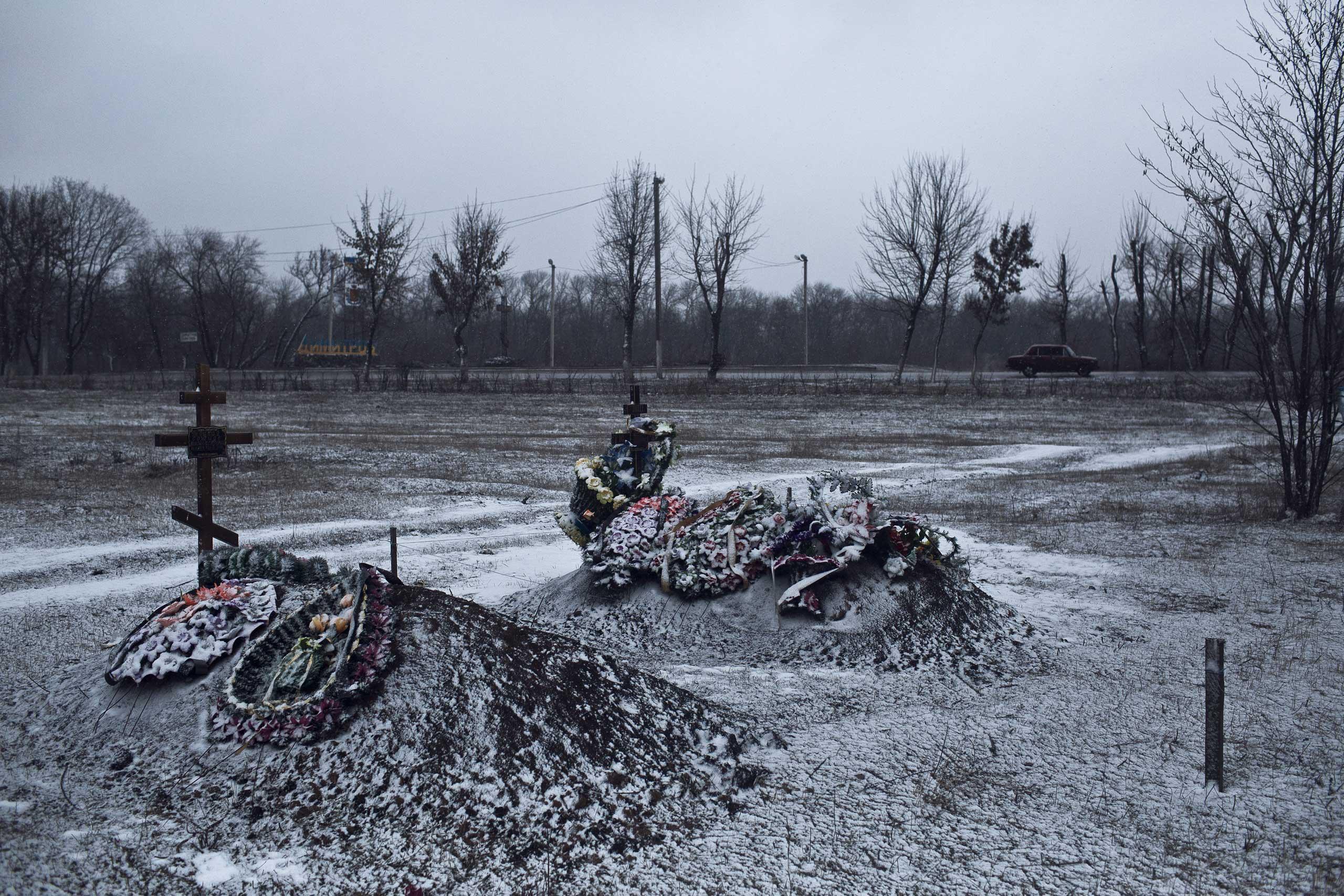 Fresh graves on the outskirts of the town of Avdiivka, Ukraine, Feb. 9, 2015.