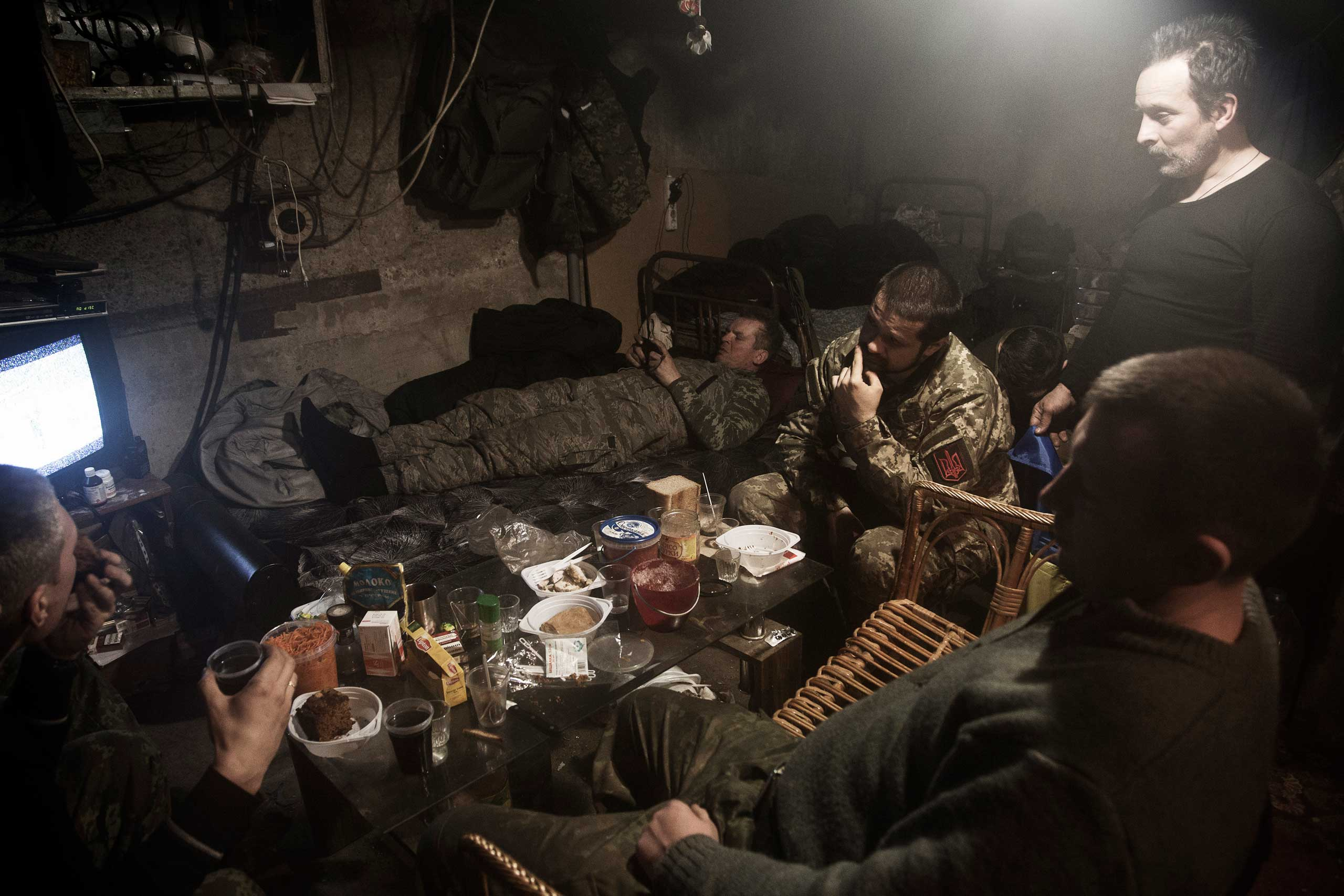 Members of the Dnipro-1 Battalion live in the basement of a destroyed house in Pisky, with food donated by the Ukrainian public, Feb. 9, 2015.