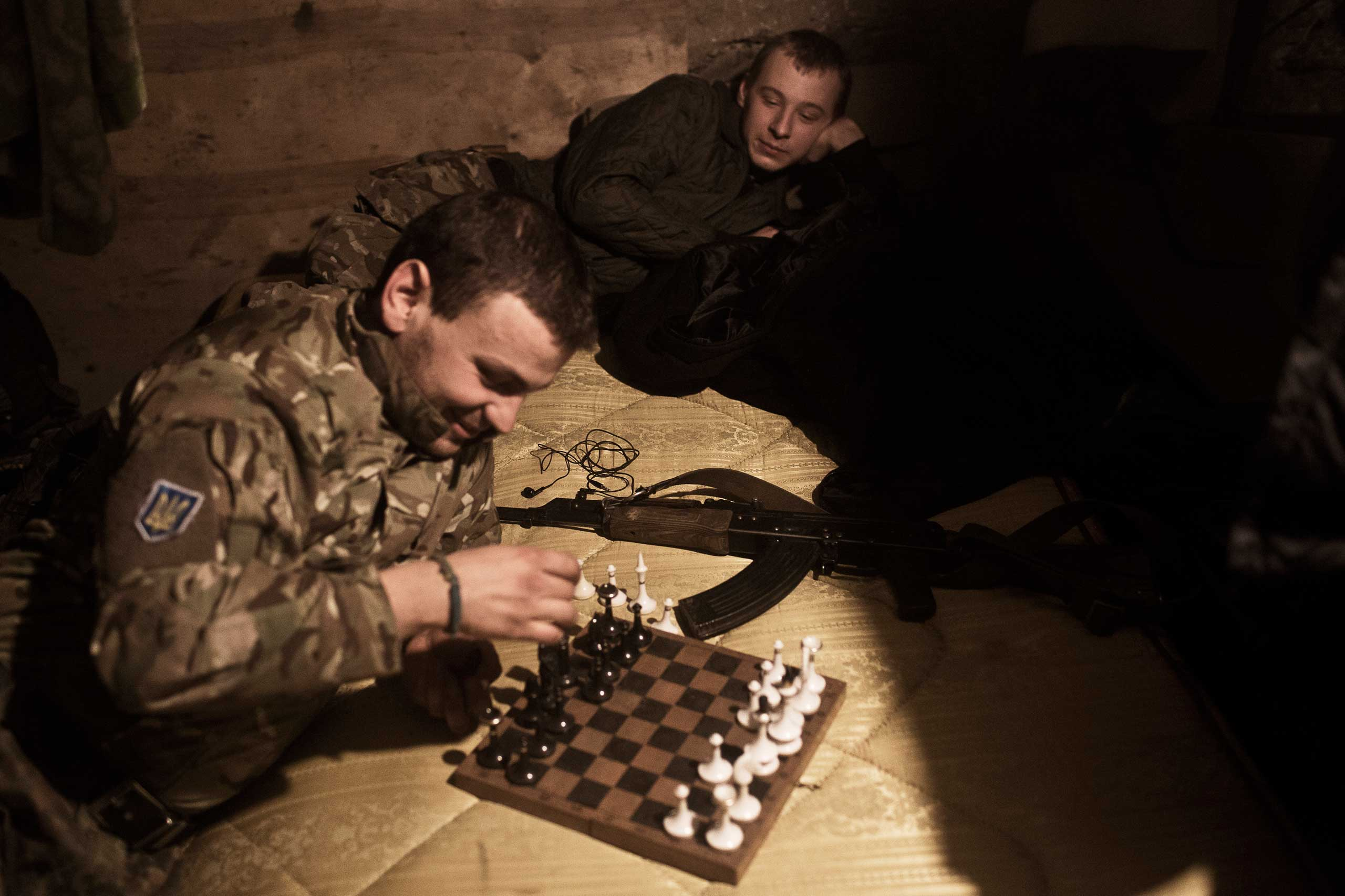 Members of the Dnipro-1 battalion play chess in their base in Pisky, Feb. 9, 2015.