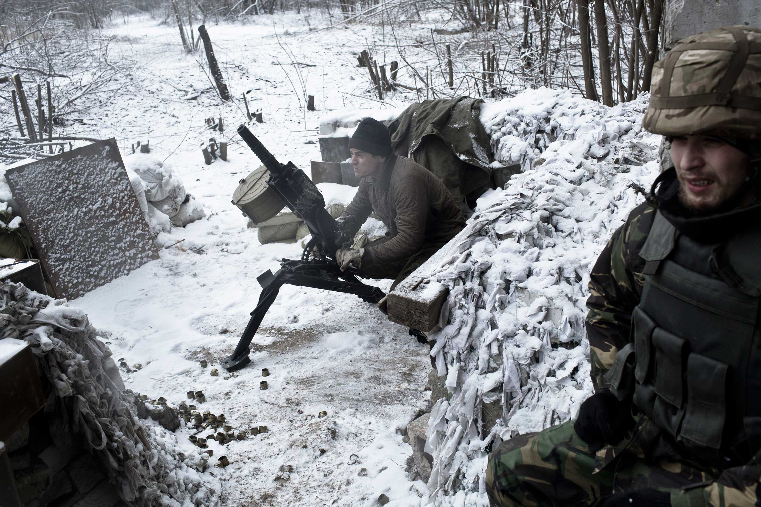 Members of the right wing Transcarpathian Sich battalion have taken over a bombed-out mine as their base on the frontline in Pisky, Ukraine, Feb. 10, 2015. They fire light artillery and machine guns at enemy positions seeking to open up a new flank against the separatists.