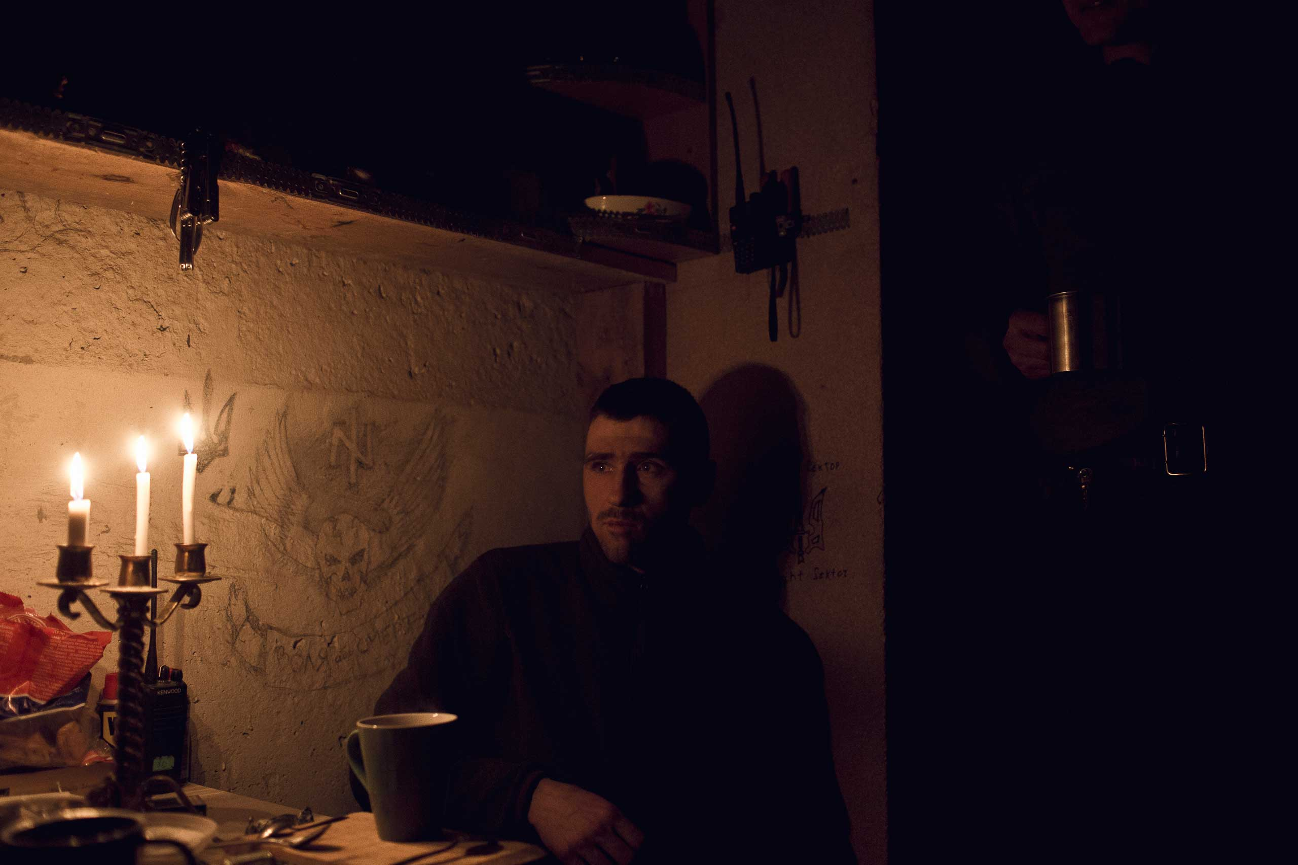 A member of the right wing Transcarpathian Sich Battalion rests in a safe room in Pisky, Ukraine, Feb. 12, 2015.