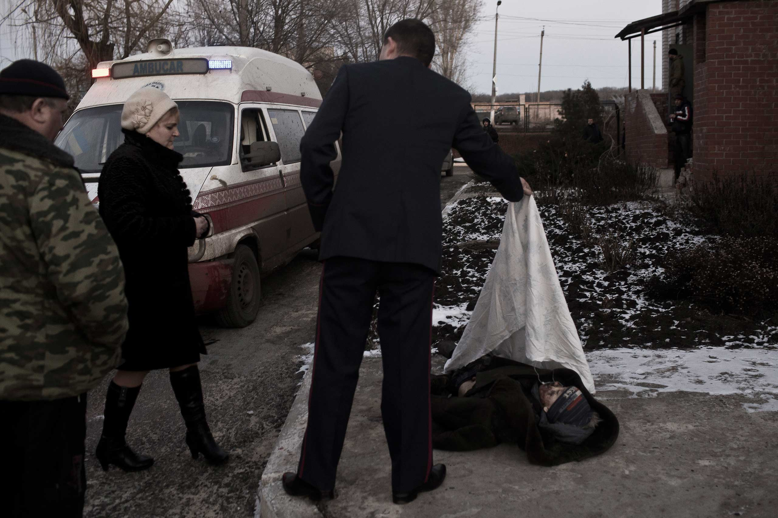 Shelling ahead of the ceasefire left one boy dead and destruction in the city of Artemivsk, near the embattled of Debaltseva, Feb. 13, 2015.