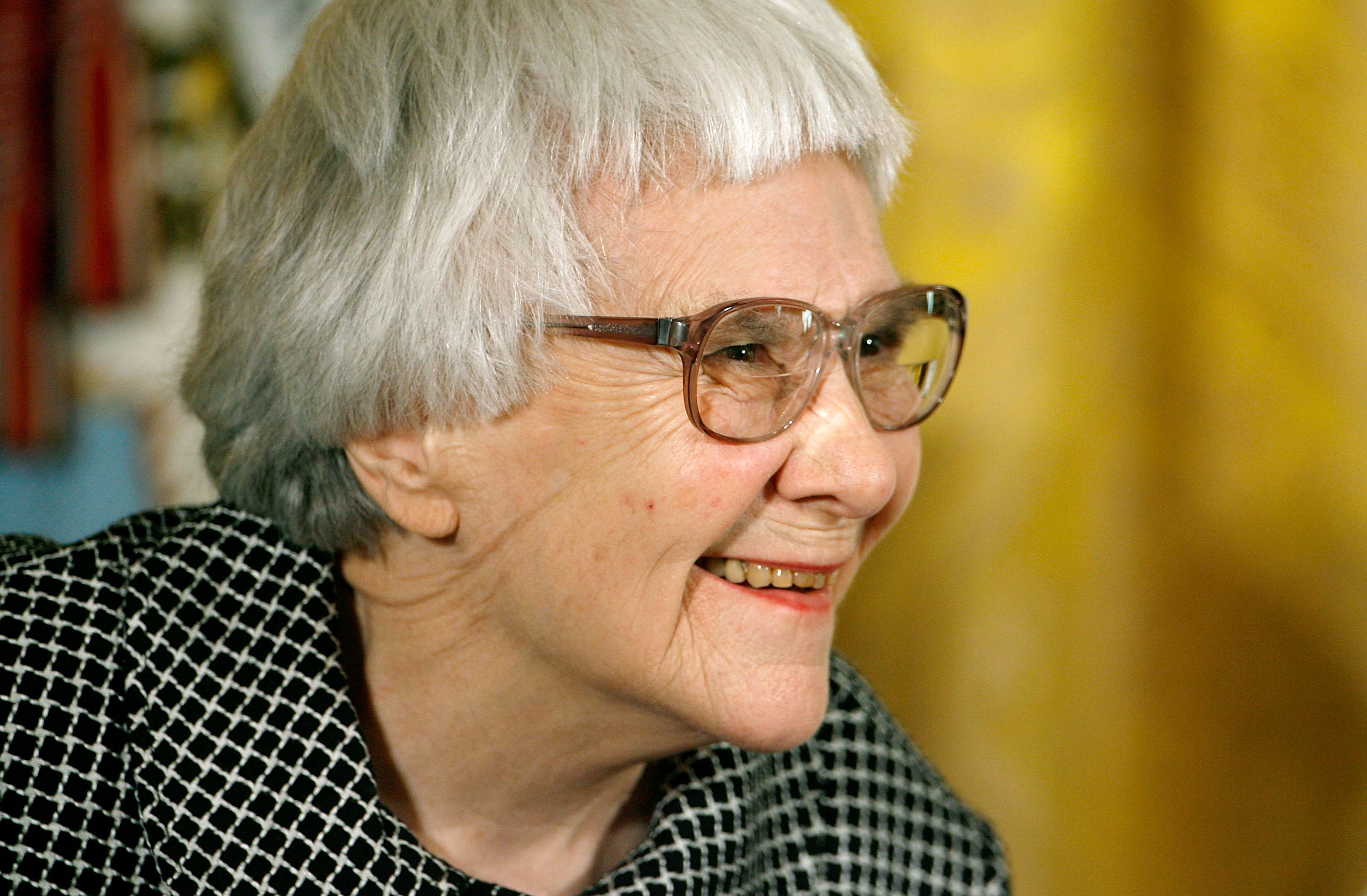 Pulitzer Prize winner and To Kill a Mockingbird author Harper Lee smiles before receiving the 2007 Presidential Medal of Freedom in the East Room of the White House, in Washington, on Nov. 5, 2007