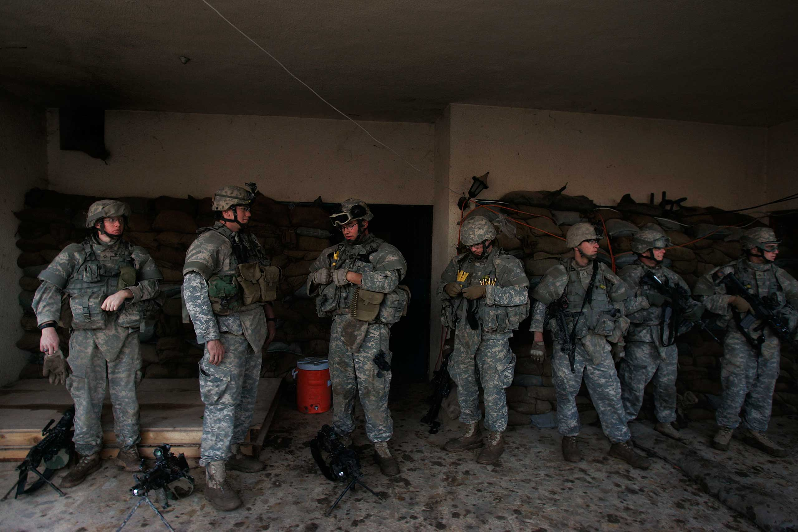 """<b>Iraq Withdrawal, Bush, 2007</b> President George W. Bush vetoed a war-spending bill in 2007 that called for the withdrawal of all military troops by the following year. """"It makes no sense to tell the enemy when you plan to start withdrawing,"""" the president said. U.S. troops left Iraq in 2011 under President Obama. (Photo: Soldiers return to Combat Outpost Casino after a mission in the Gazaliyah neighborhood of Baghdad, Iraq on Feb. 16, 2007.)"""