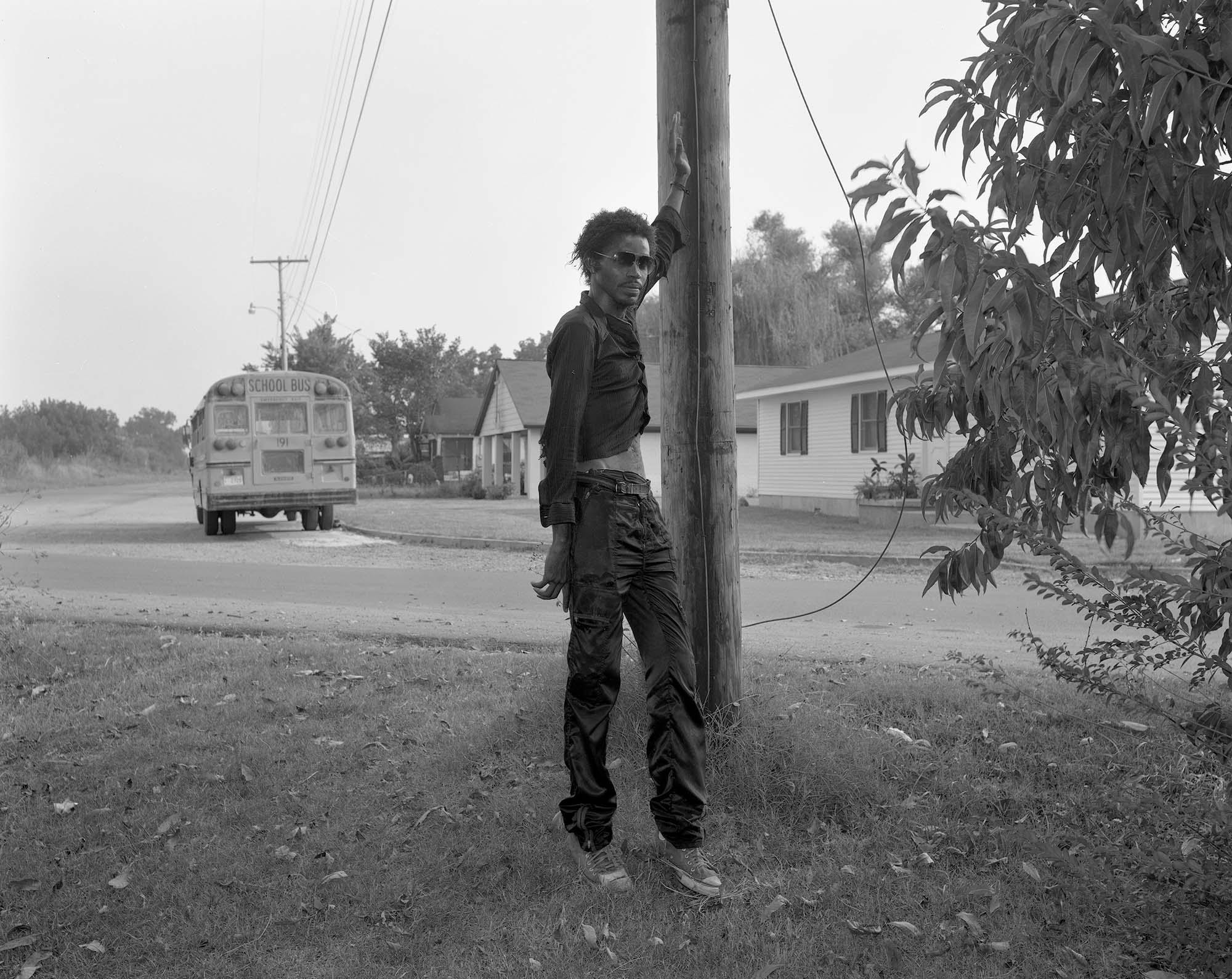 Man and school bus, Tutweiller, Ms., 1986.