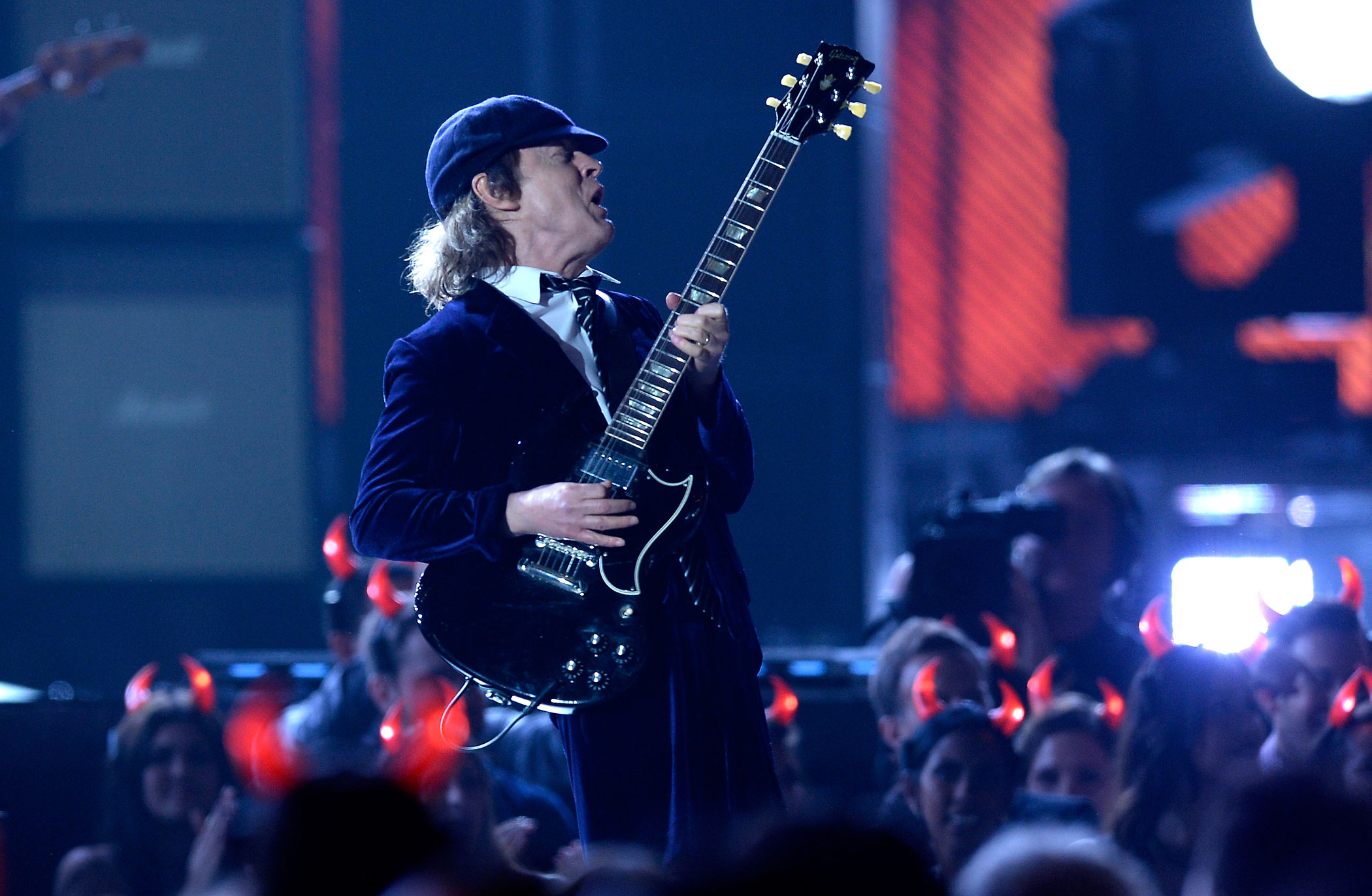 Angus Young of AC/DC performs onstage during the 57th Annual Grammy Awards at the Staples Center in Los Angeles on Feb. 8, 2015