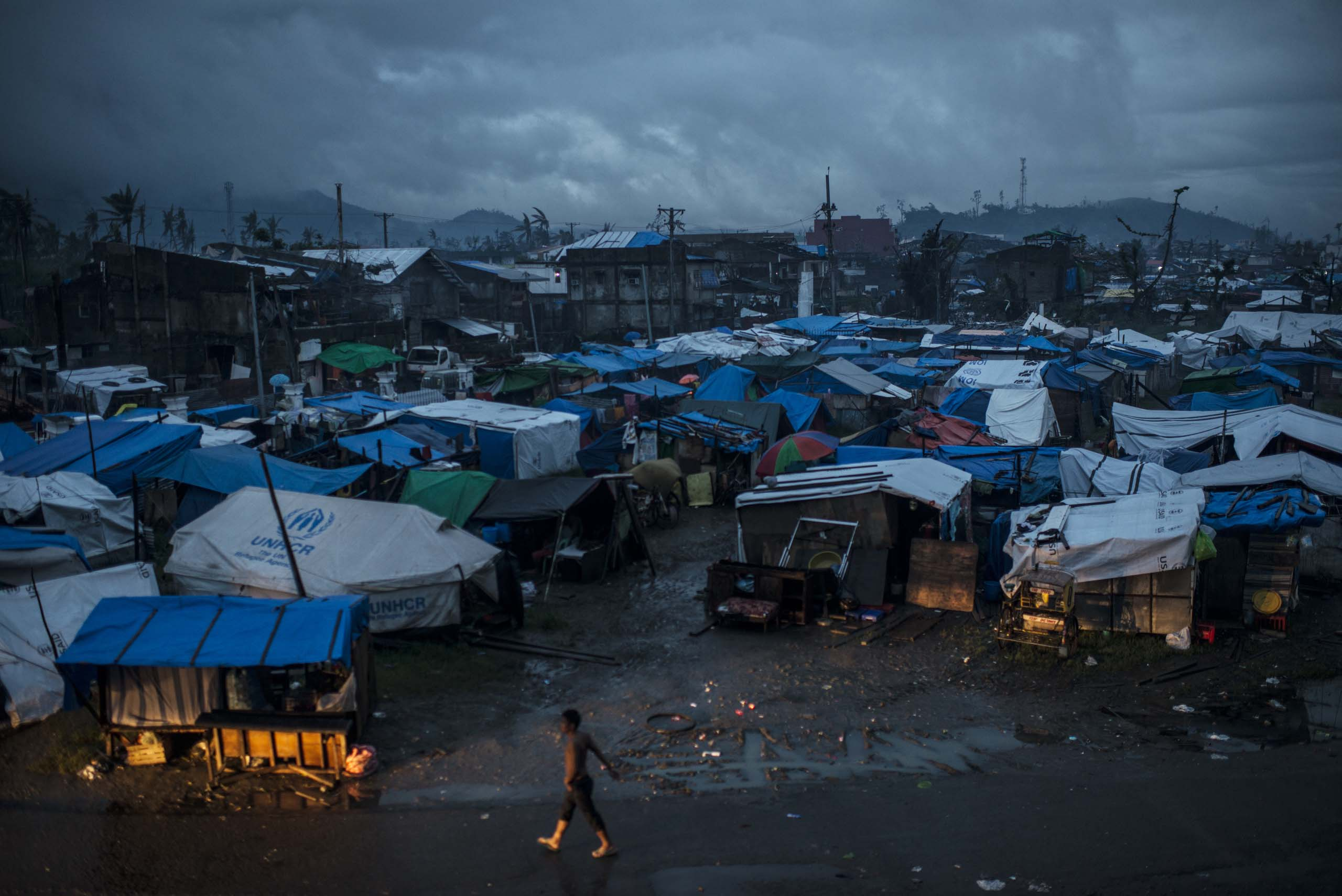 Jan. 13, 2014: Residents displaced by Typhoon Haiyan live in  tents outside the stadium in Tacloban, in the Philippines.
