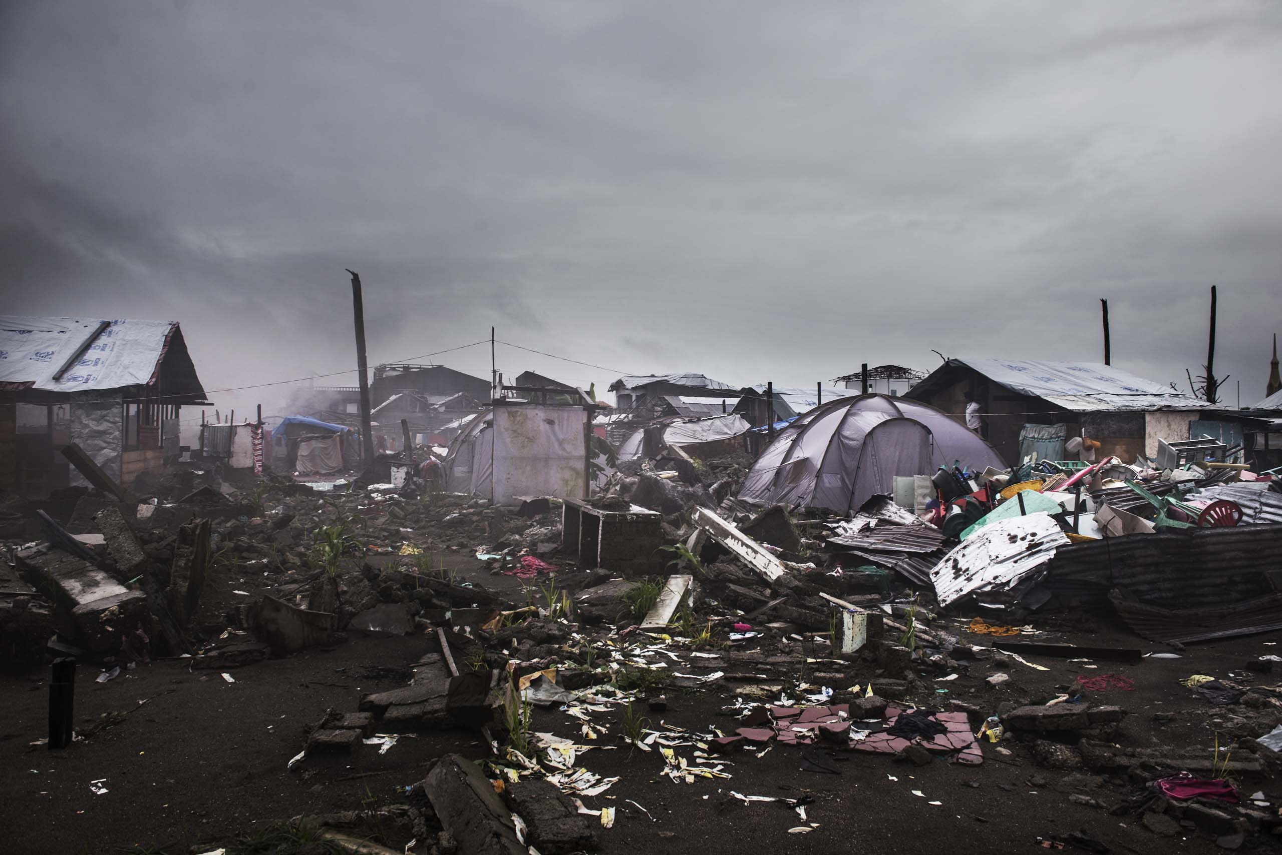 Jan 13, 2014: Damaged houses in Palo outside of Tacoloban. Typhoon Haiyan hit the Philippines on November 8, 2013, and killed some six thousand people, and affected some 14.1 million others, destroying their homes, livelihoods, and displacing families.  There is an estimated 230,000 pregnant women in the affected area, with much of the medical infrastructure destroyed