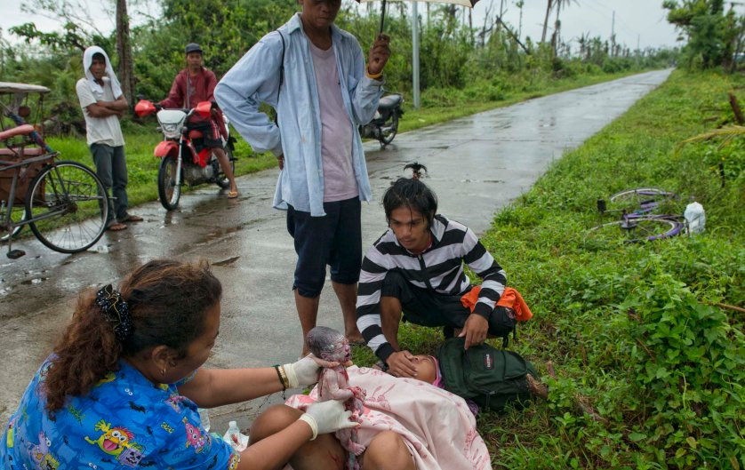 Jan. 11, 2014: Analyn Pesado, 18, gives birth on the side of the road en route to the nearest clinic in Tolosa, outside of Tacloban.