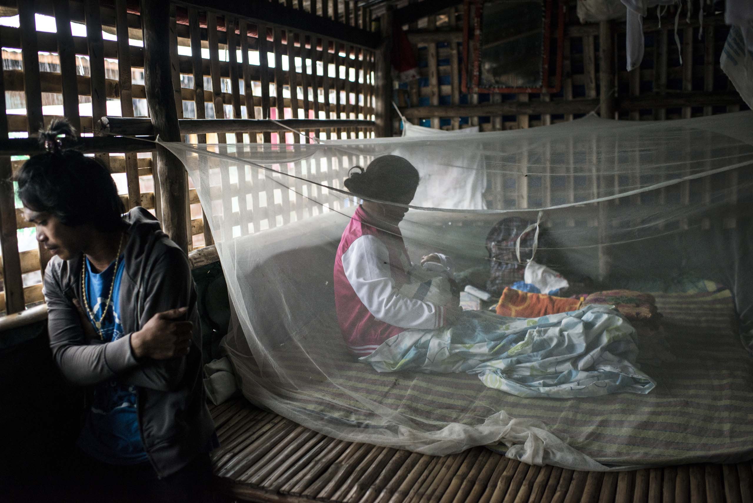 Jan.12, 2014: Analyn Pesado and Ryan Bacate at home with their new born baby Ryan Jr., in Telegrafo, a small town outside of Tacloban, in the Philippines.