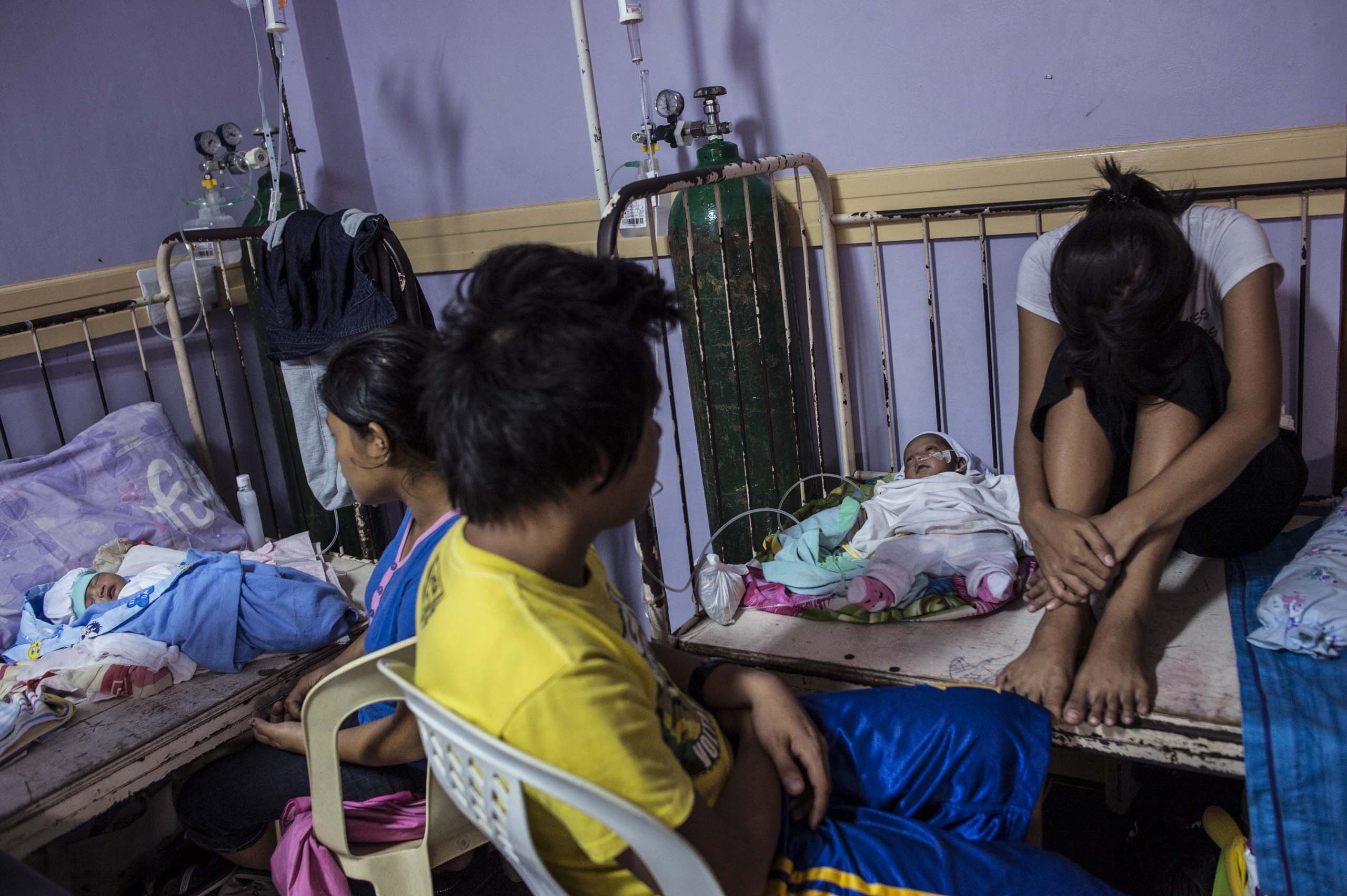 Jan. 12, 2014: Families at the neonatal intensive care unit (NICU) at a government hospital in Tacloban. Overcrowding is due to mothers with a higher number of complications in pregnancy and lack of prenatal care.