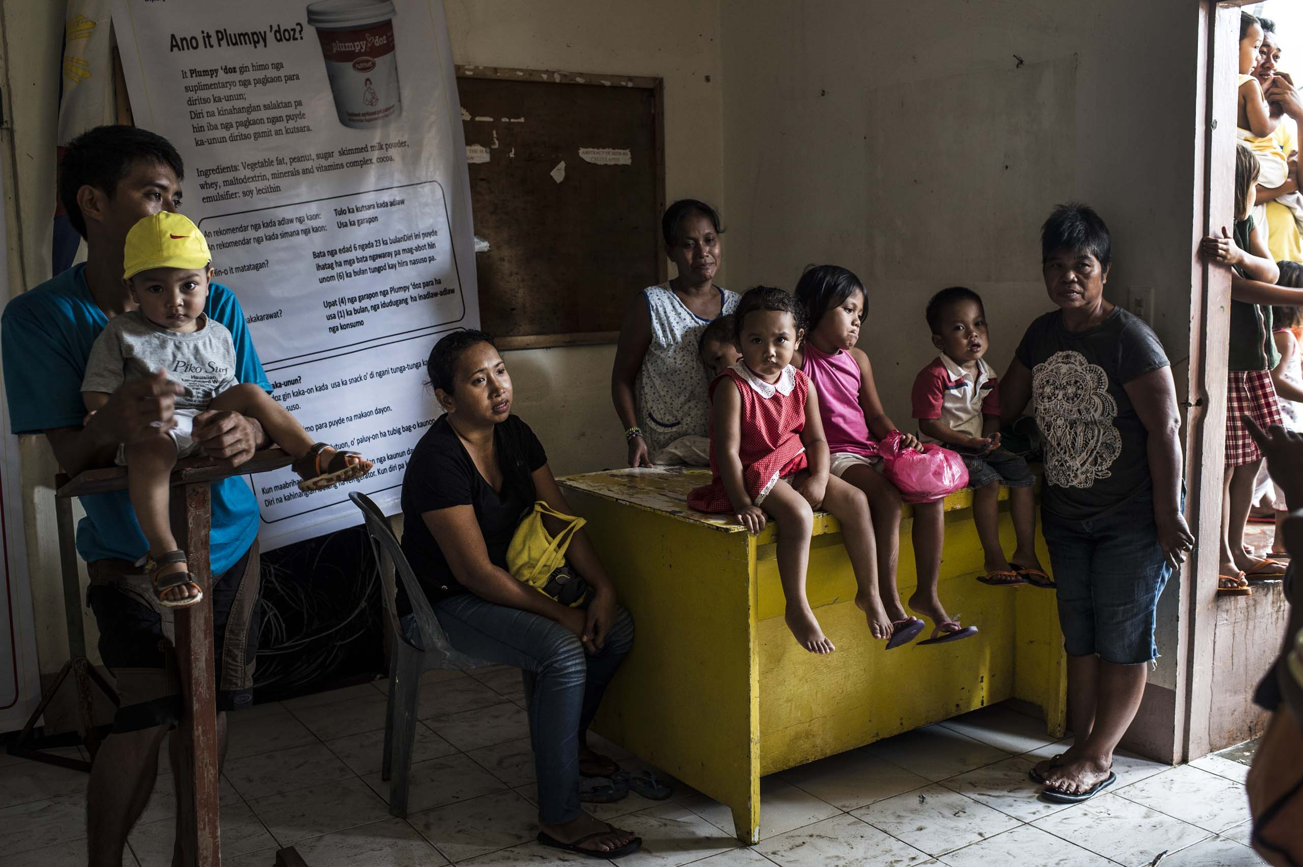 Jan. 15, 2014: Children and parents wait for Save the Children staff who are conducting  nutritional assessments and distributing  plumpy nut and biscuits for children under five in Palo, outside of Tacloban, in the Philippines.