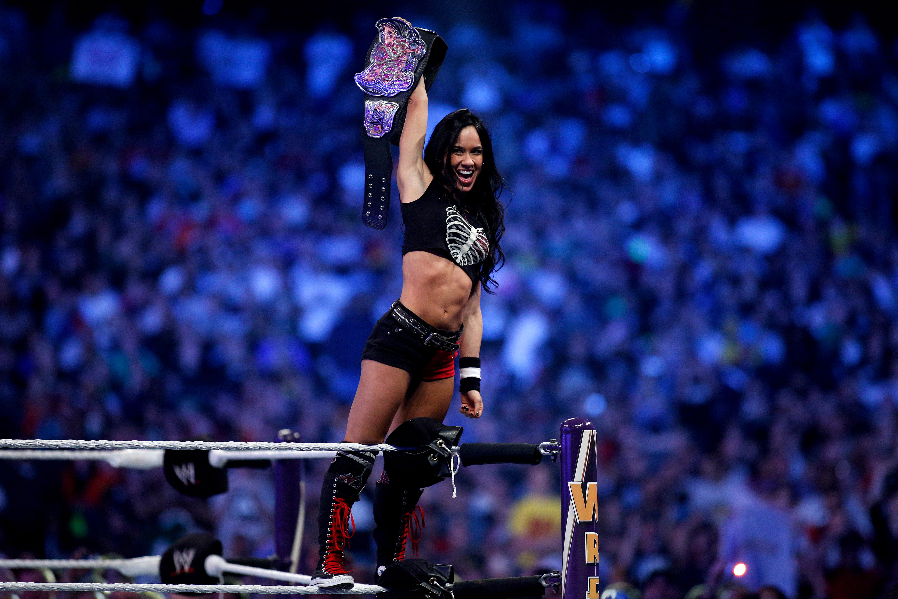 AJ Lee celebrates after winning the Divas Championship Invitational during Wrestlemania XXX at the Mercedes-Benz Super Dome in New Orleans on Sunday, April 6, 2014. (Jonathan Bachman—AP)