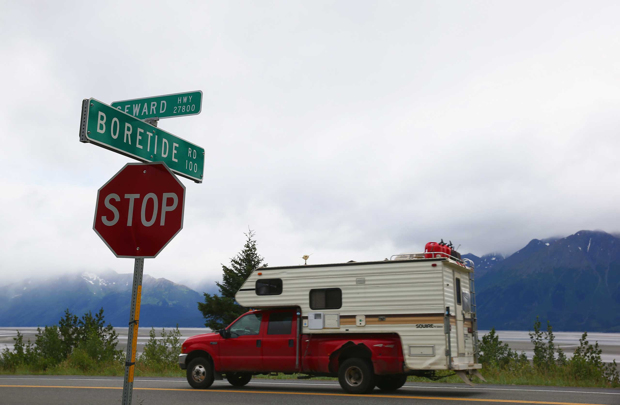 A truck passes a street sign named for the Bore Tide at Turnagain Arm on July 11, 2014 in Anchorage, Alaska.