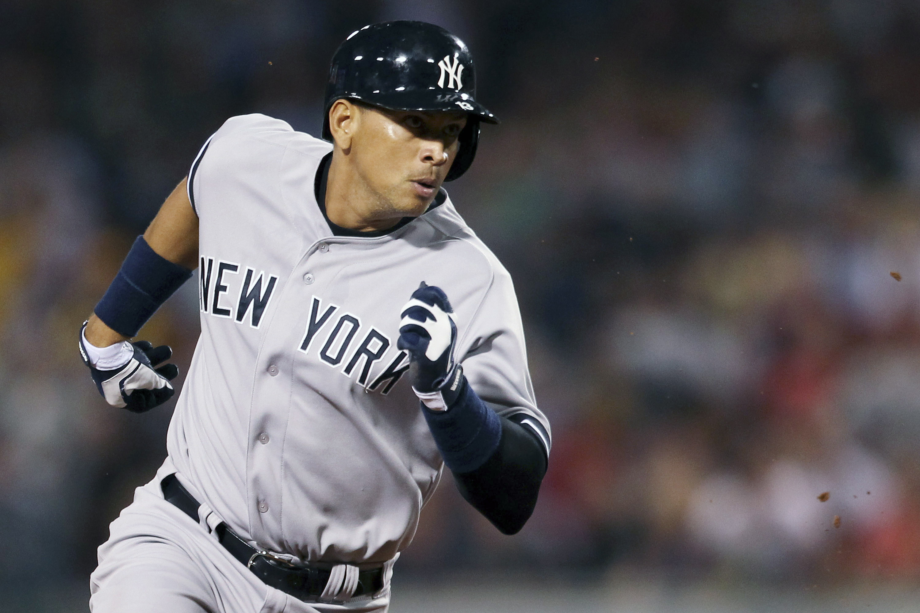 New York Yankees' Alex Rodriguez runs to third base in their MLB baseball game against the Boston Red Sox in Boston on August 18, 2013