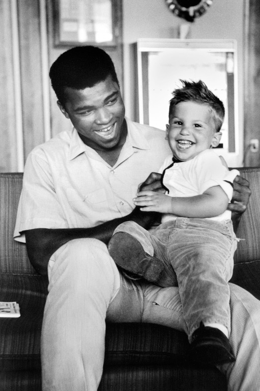 Ali with the photographer's son Corey in Lewiston, Maine, 1965                                                              Bob Gomel:  Ali has two personas — one public, one private. With my wife, two boys and our German shepherd in tow, I covered the preparation for his rematch with Sonny Liston in Lewiston, Maine, for LIFE magazine. Ali could not have been more solicitous and caring. He and his brother Rahaman kept a kosher Muslim kitchen at Jack Paar's hotel and provided sterilization of the reusable milk-bottle nipples for our youngest son Barry. The braggadocio and histrionics were strictly for show. The Ali we knew was a considerate and warmhearted man.    Bob Gomel is a former LIFE magazine photographer.