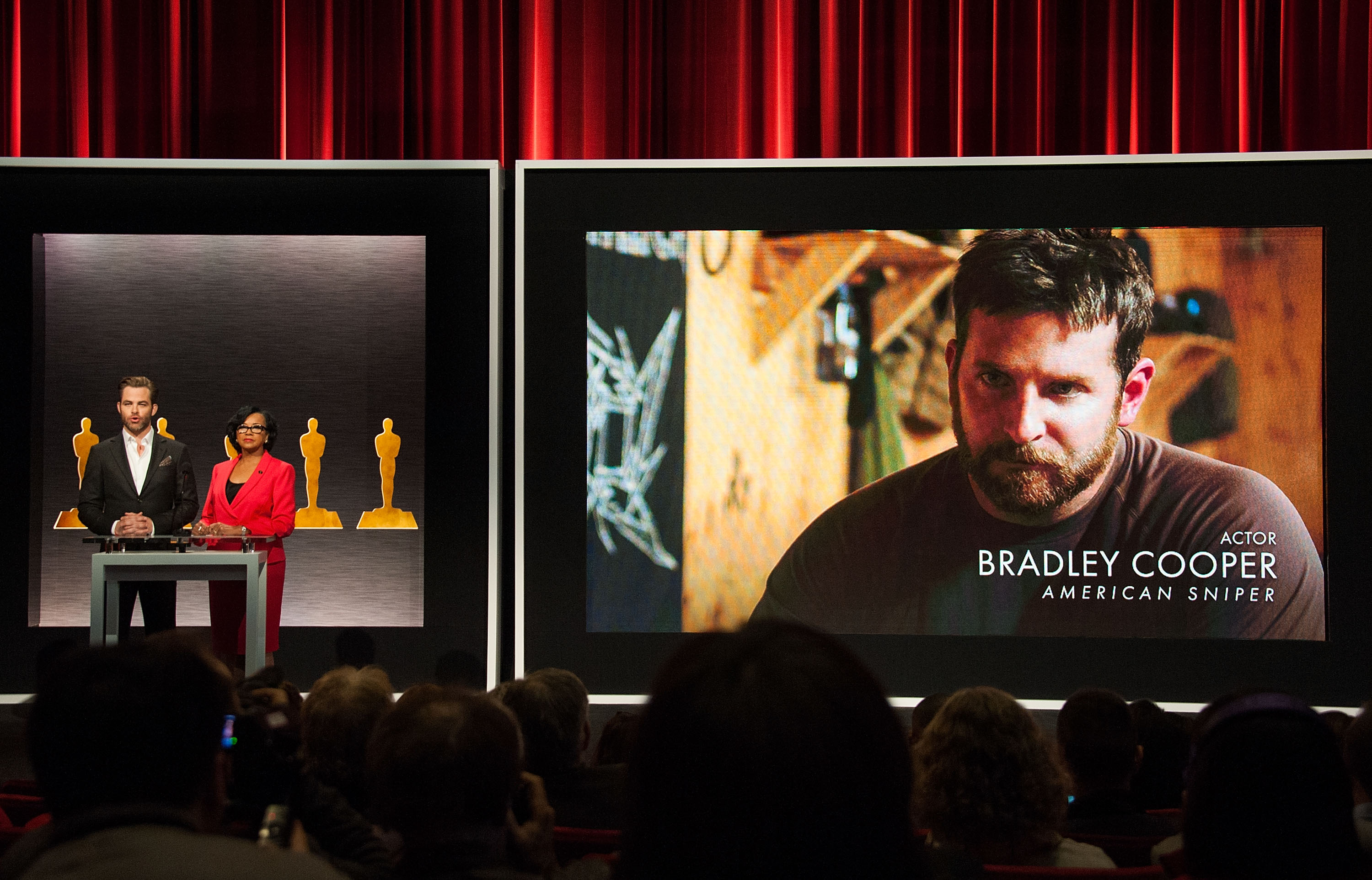 From left: Actor Chris Pine and Academy President Cheryl Boone Isaacs announce Bradley Cooper as a nominee for Best Actor in the film American Sniper at the 87th Academy Awards Nominations Announcement on Jan. 15, 2015 in Beverly Hills, California.