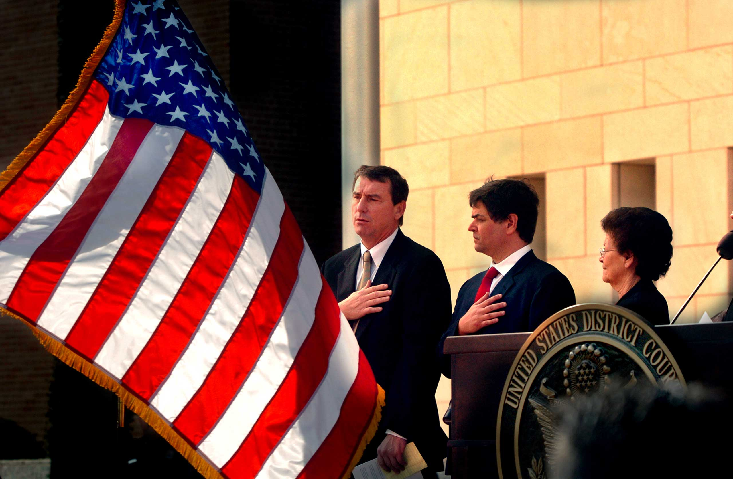 U.S. Southern District Judge Andrew S. Hanen, left, recites the Pledge of Allegiance during the United States Courthouse naming ceremony in Brownsville, Texas, Nov. 14, 2005.