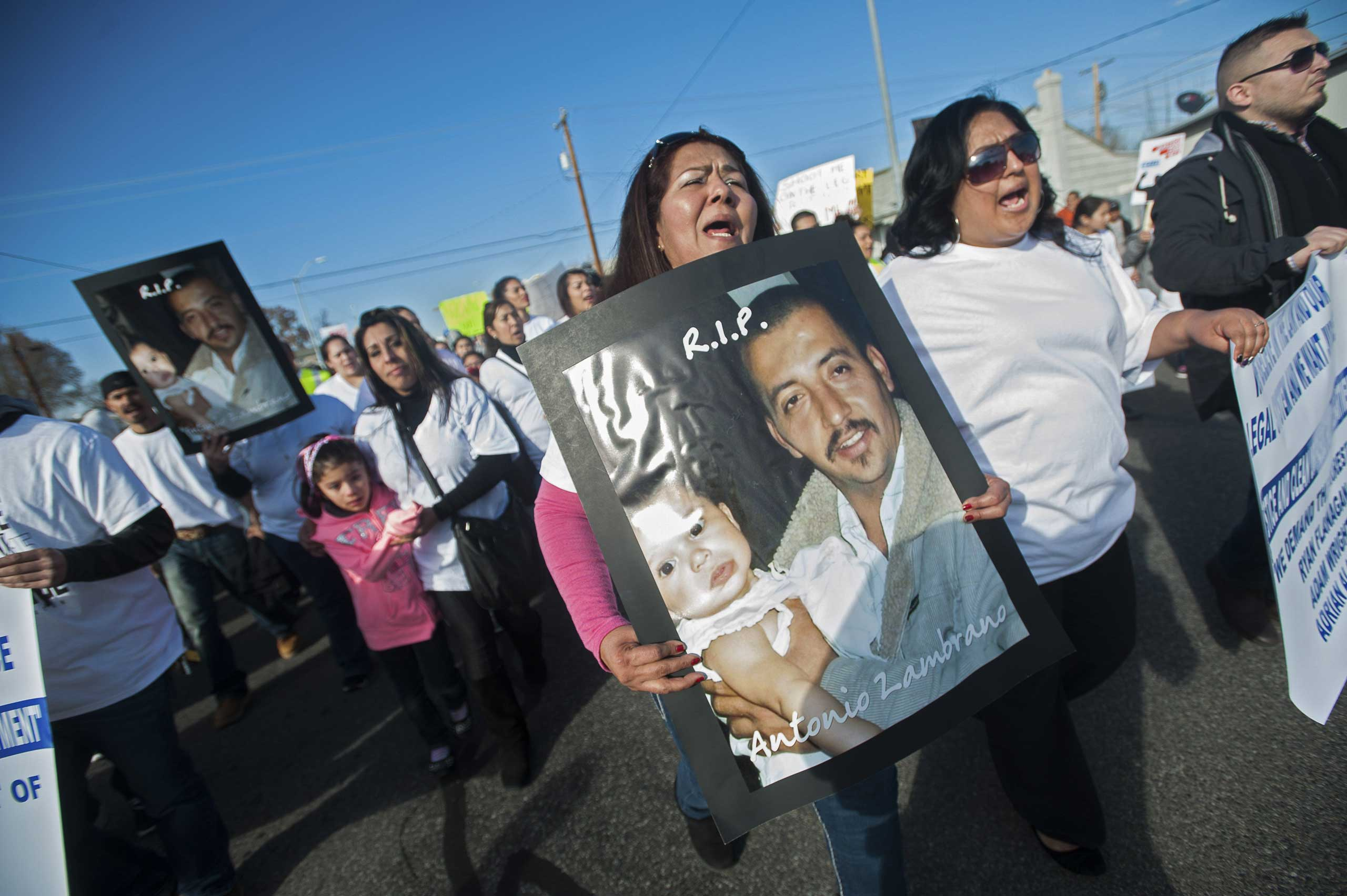 Marchers carry posters of Antonio Zambrano-Montes during a protest over the police killing of the Mexican-born apple picker, in Pasco, Wash., Feb. 14, 2015.